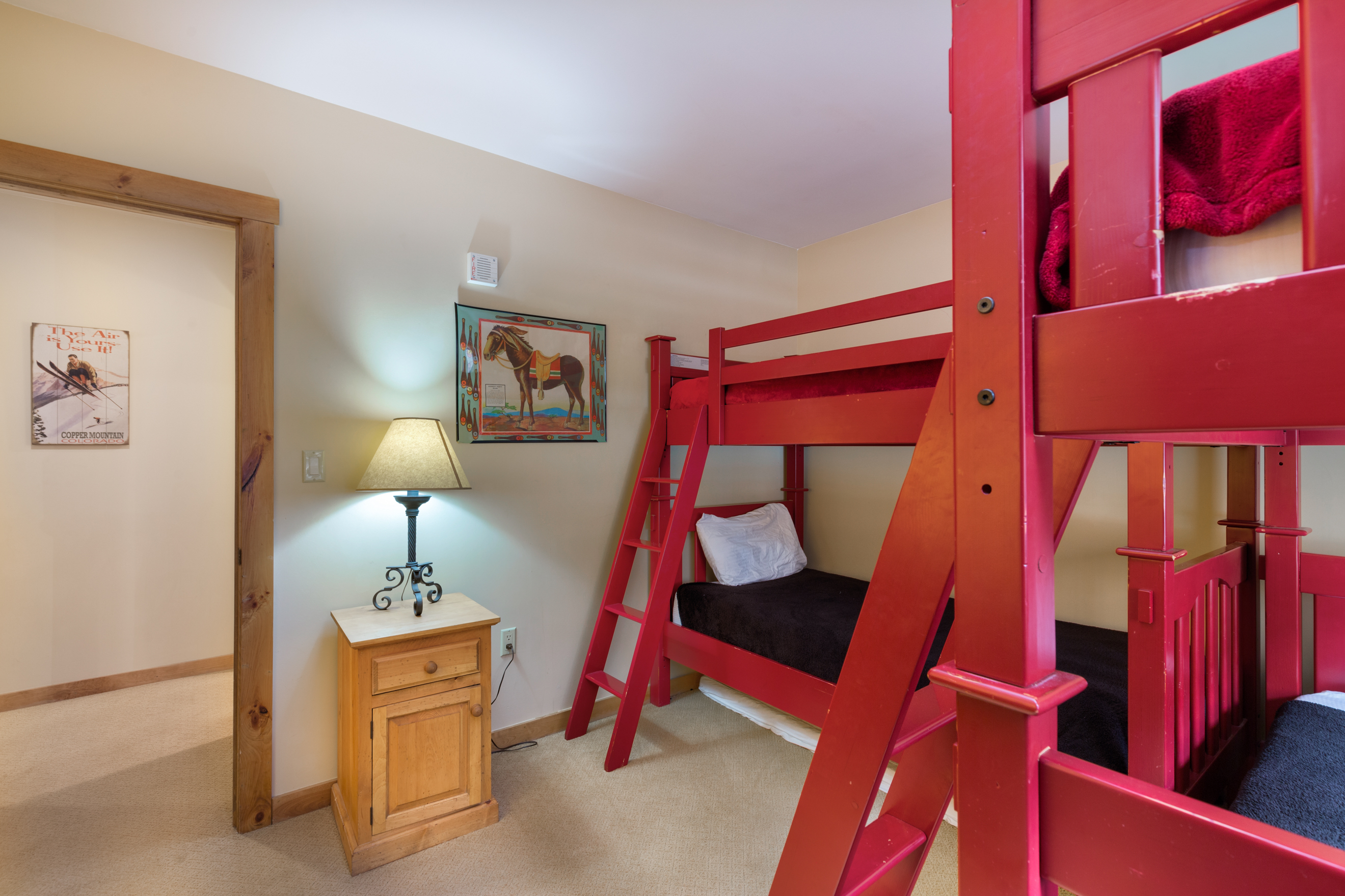 The guest bedroom sleeps four with two bunk beds.