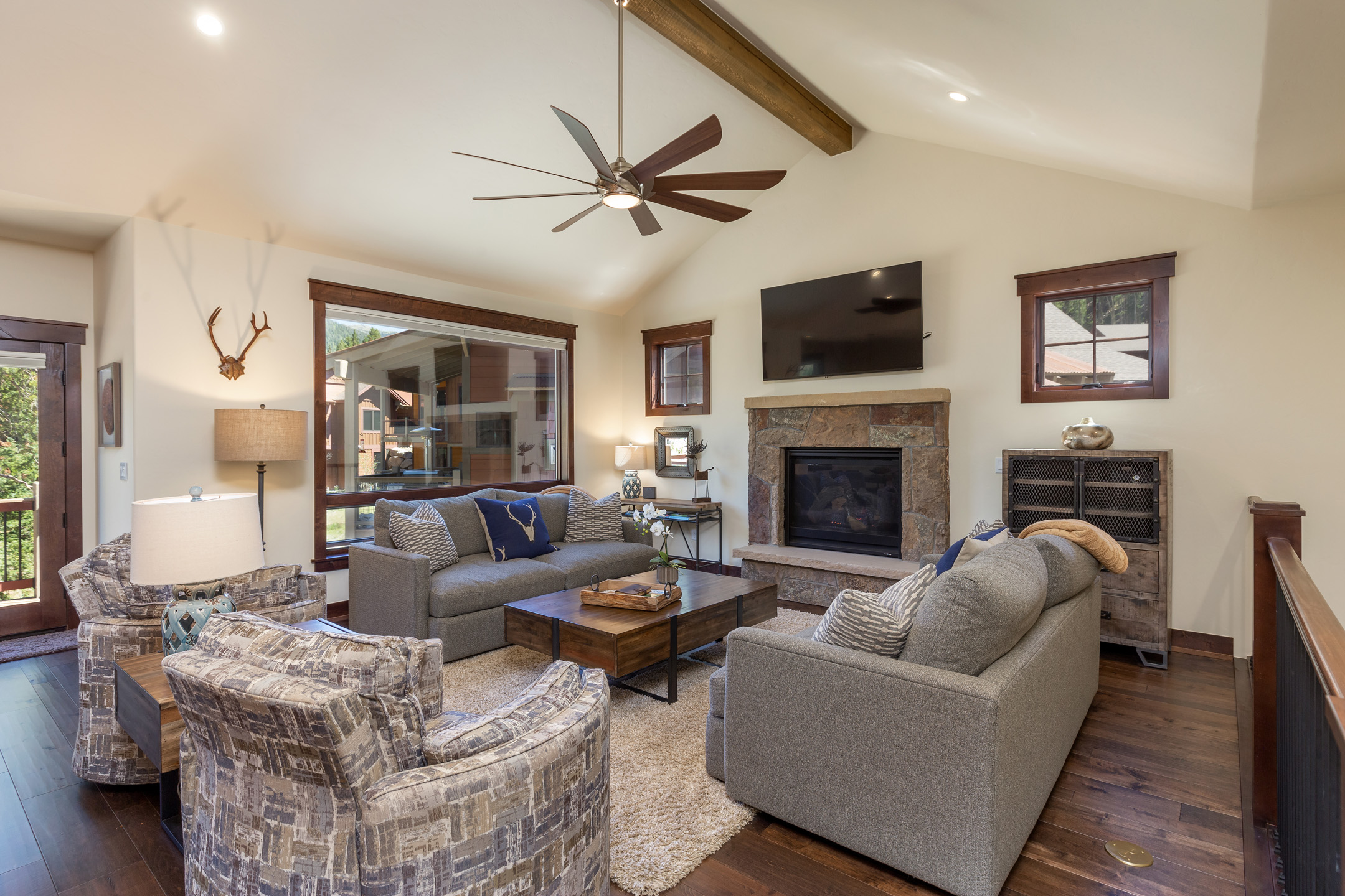 Alders #747: The living room features a stone fireplace that you can enjoy after a long day skiing or exploring Keystone.  The main living room also has large windows to see the stars at night and amazing views during the day.