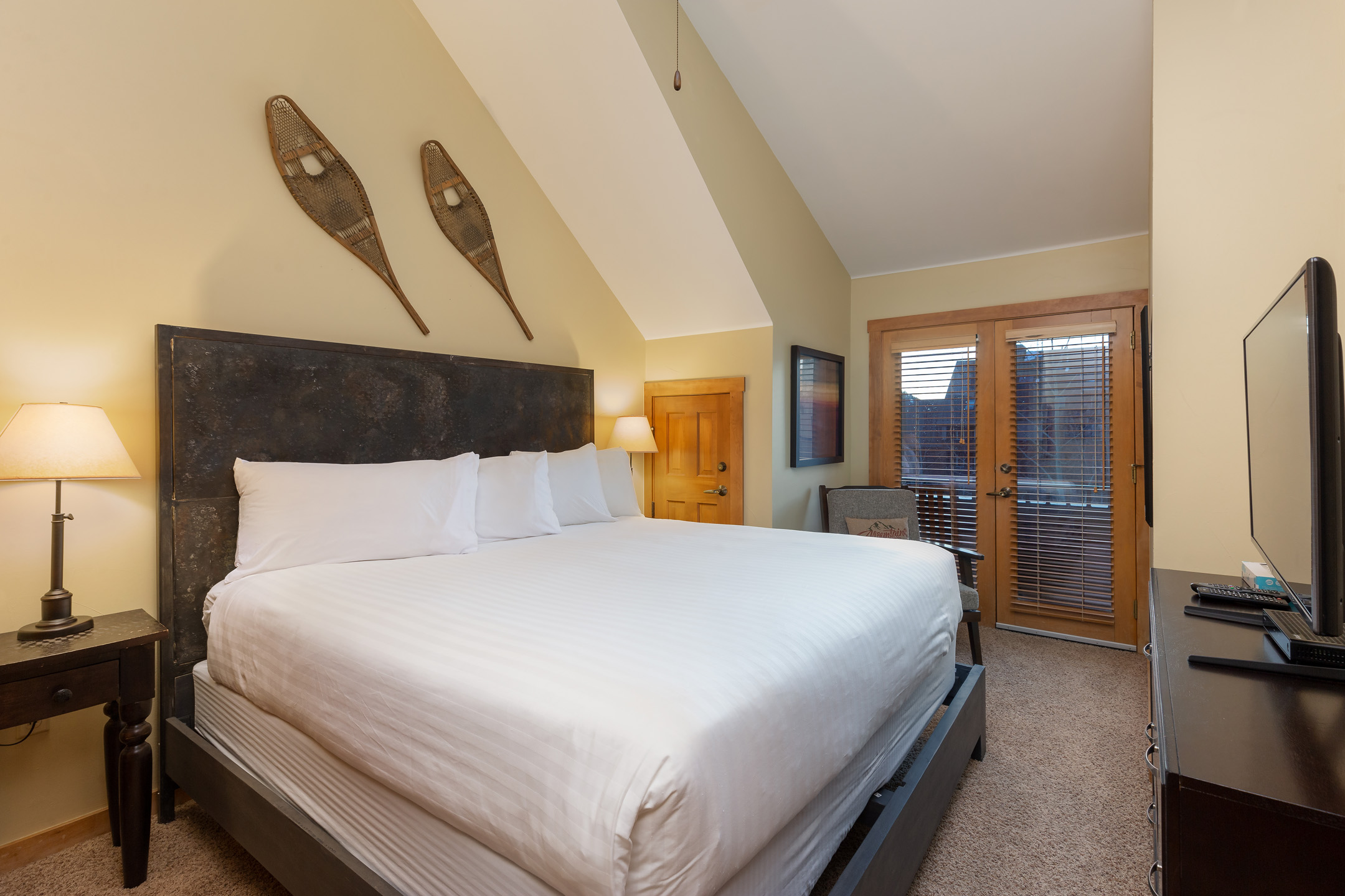 The bedroom features a king-sized bed on our Ivory White Bedding program, a flat screen TV and its own access to the main balcony.