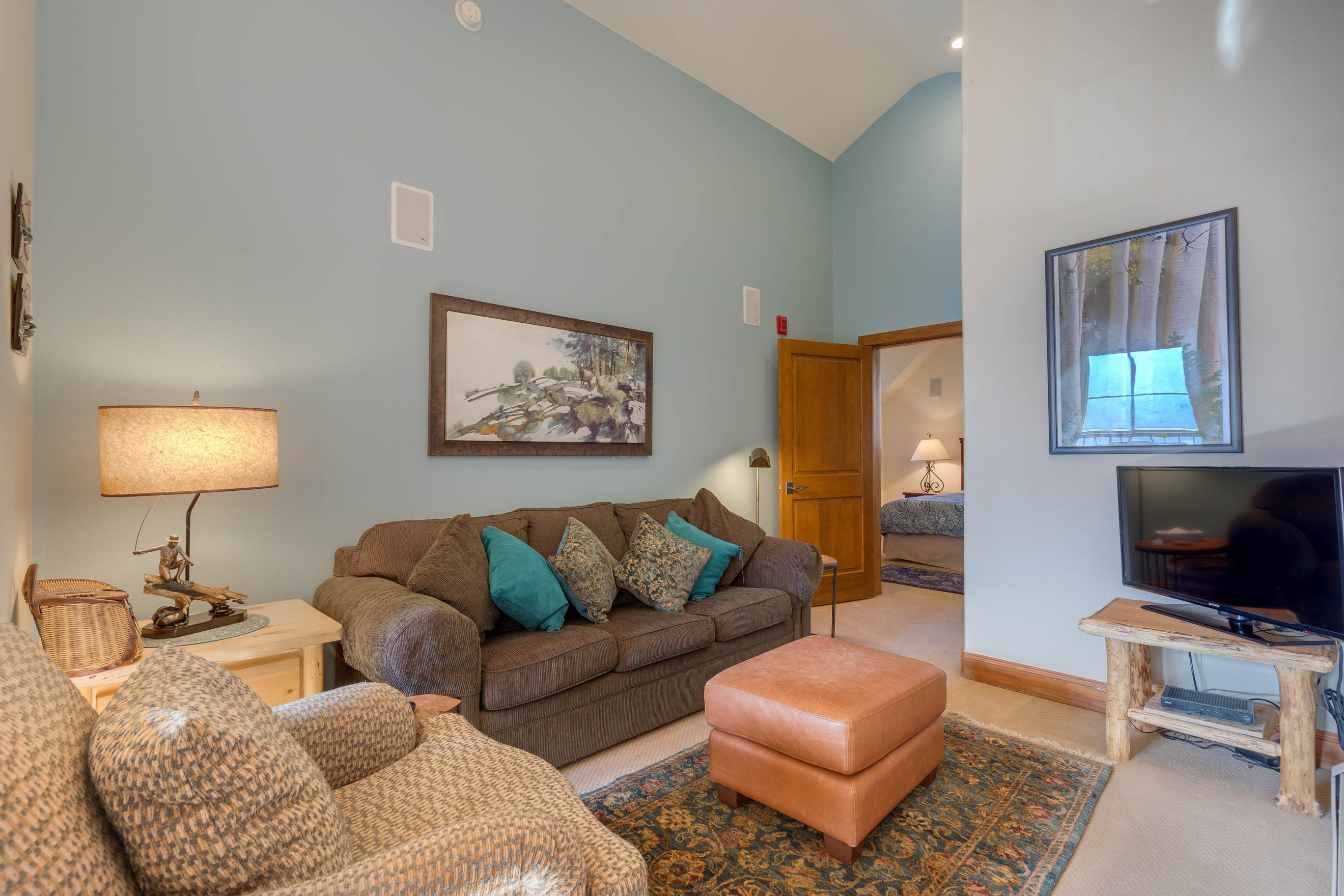 The upstairs loft features a queen-sized sleeper sofa and a flat screen TV.