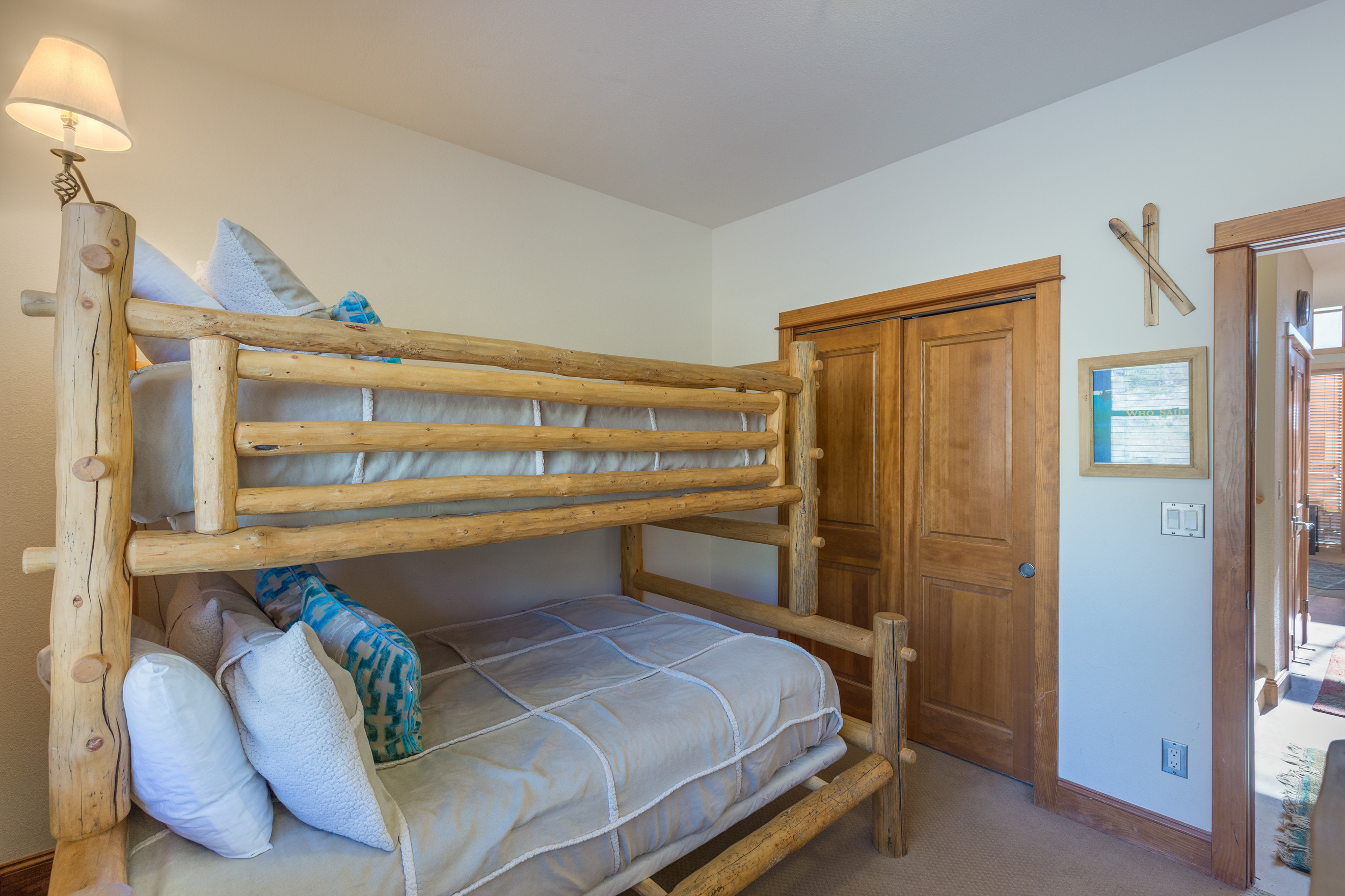 The second guest bedroom features a twin-over-full bunk bed.