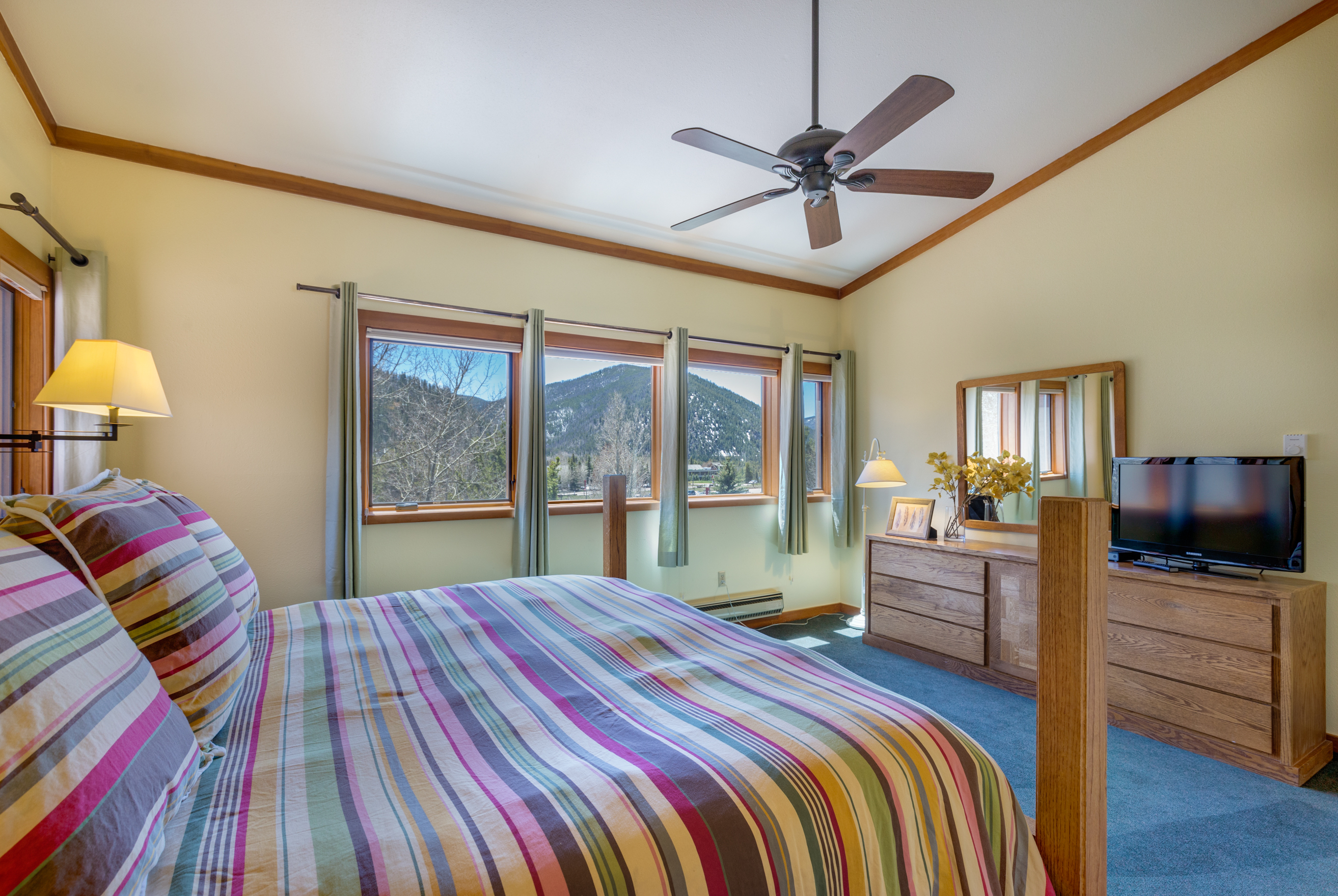 The master bedroom features a king-sized bed, a flat screen TV and an en suite bathroom.