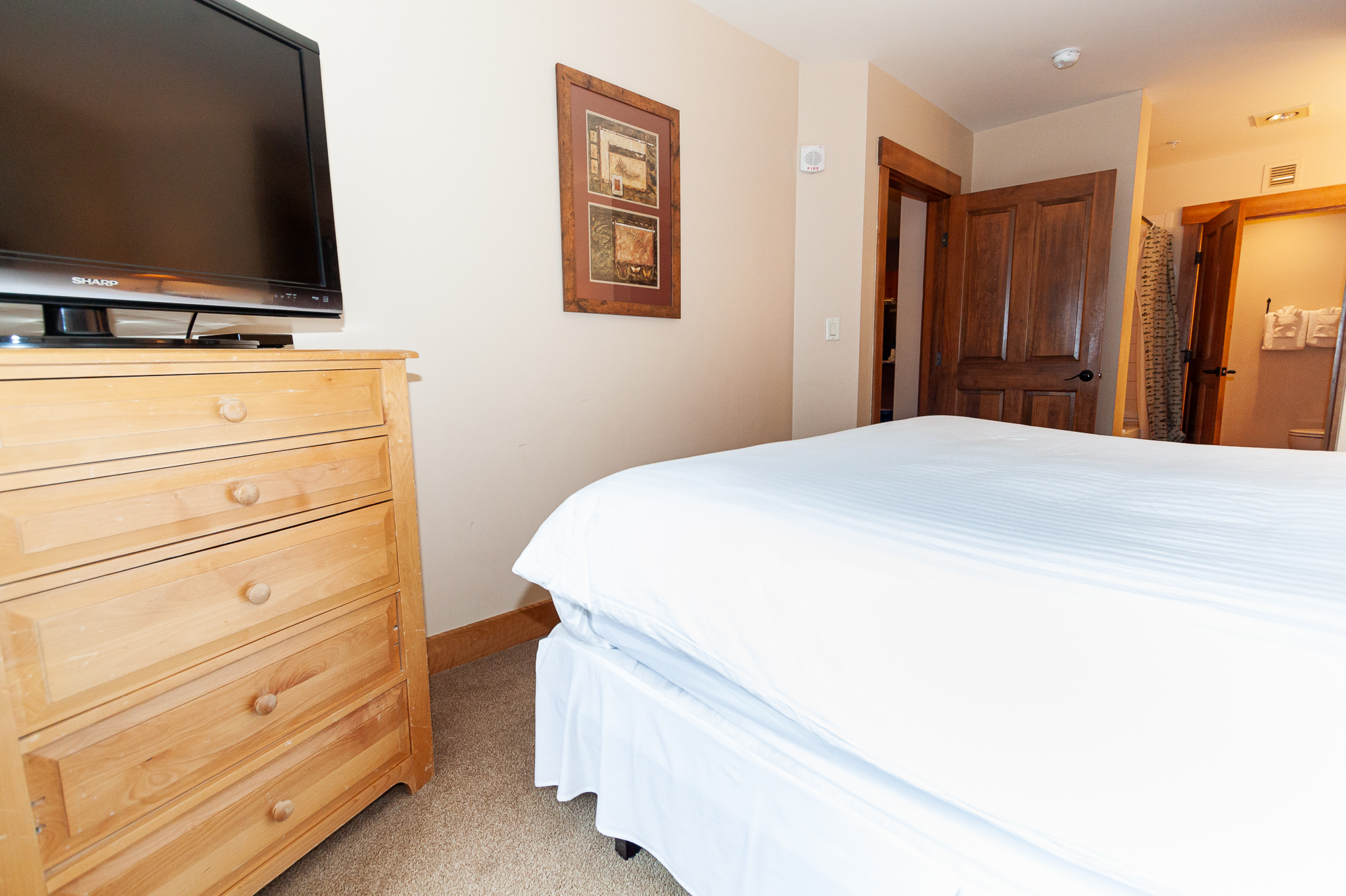 The master bedroom features a king-sized bed, flat screen TV and its own private bathroom.