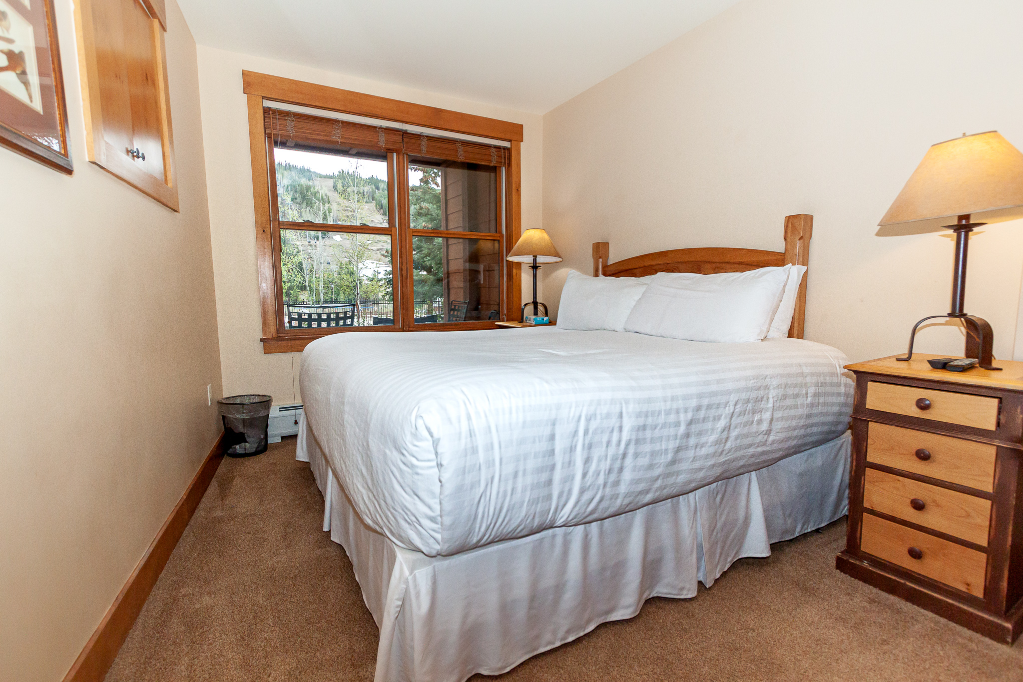 The guest bedroom features a king-sized bed and a flat screen TV.