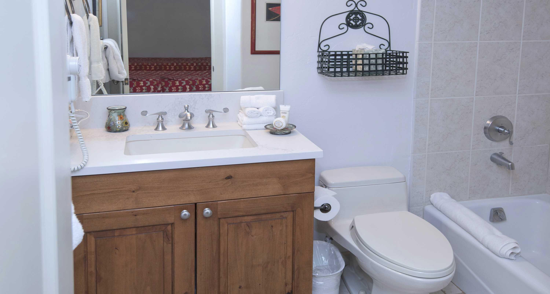 The door to en-suite bathrooms is located in the bedroom