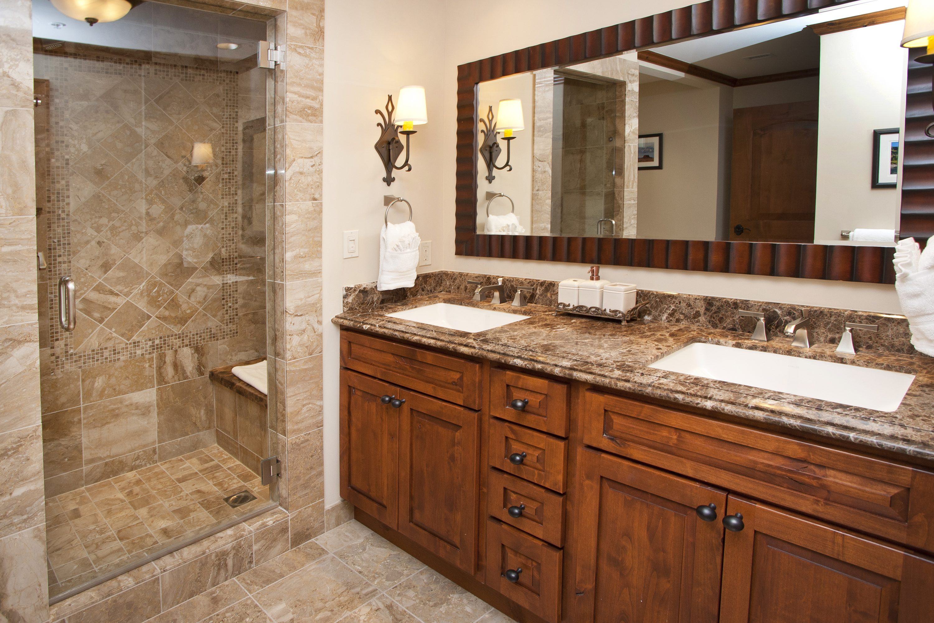Luxury spacious bathroom with his and her sinks.  Relax in the steam shower/tub