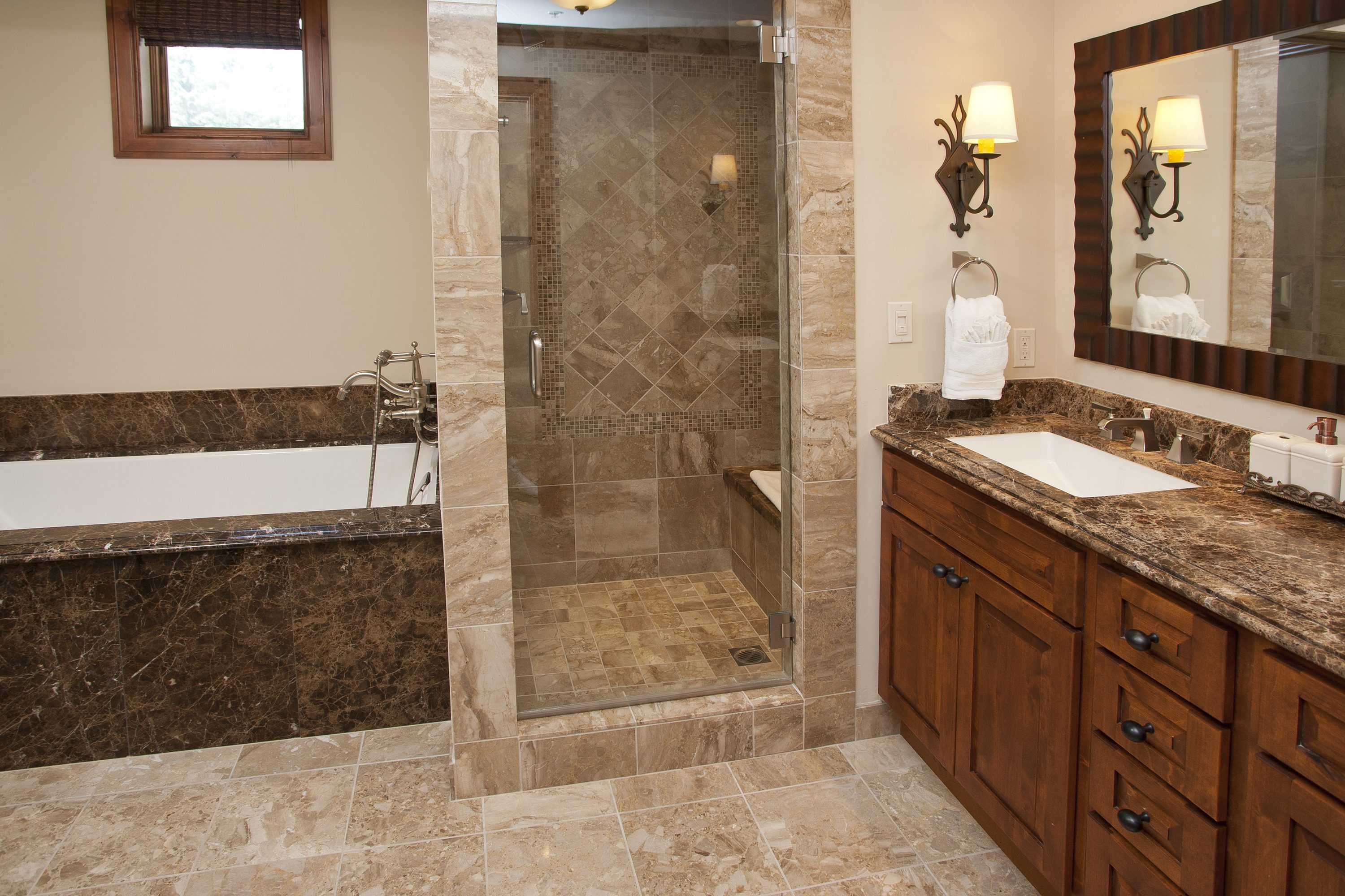 Spacious master bathroom and deep soak tub with natural light