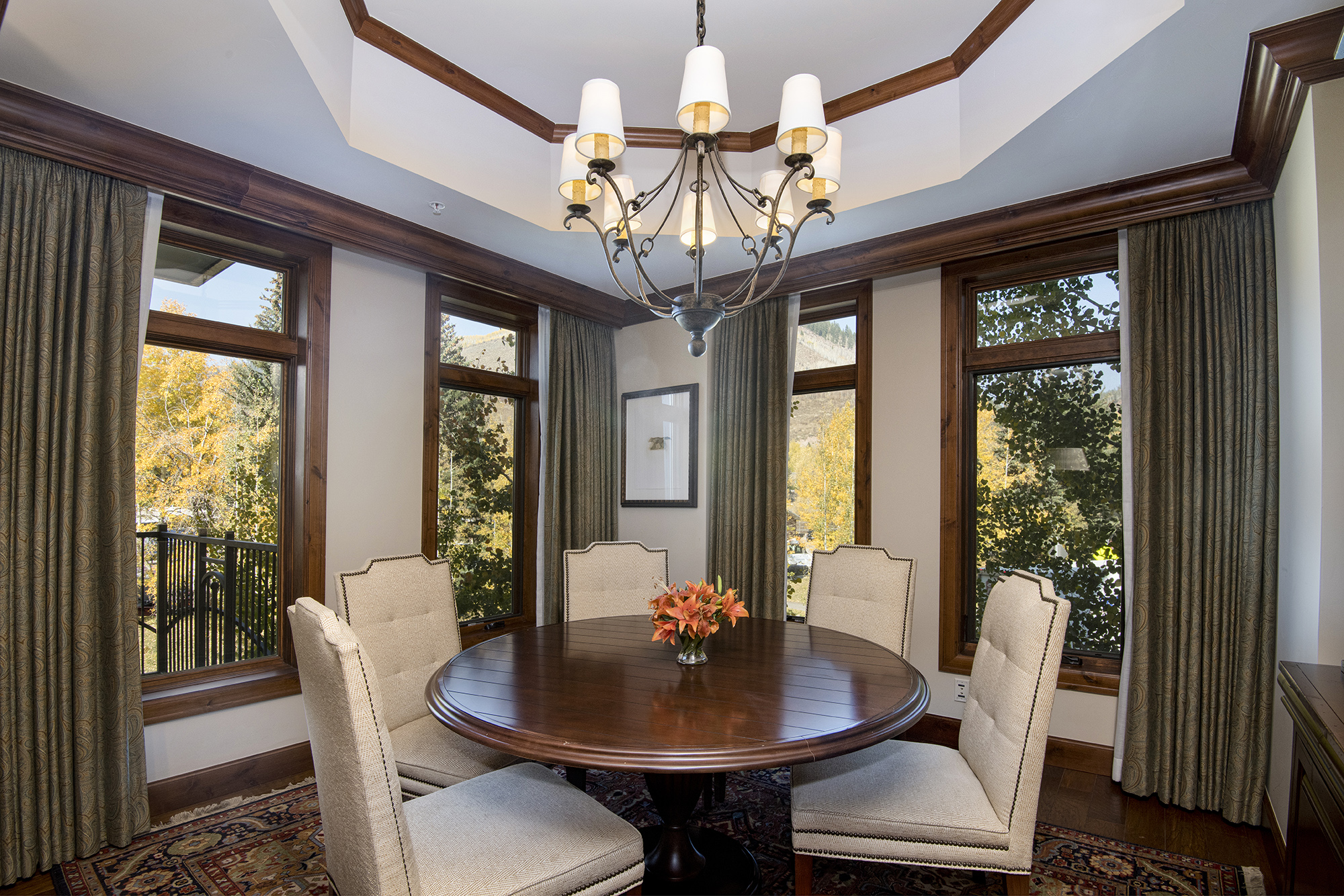 Separate dining room surrounded by mountain views