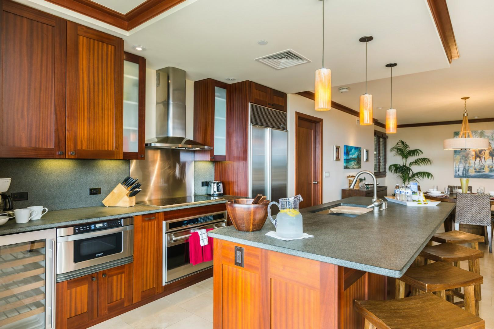 Gourmet kitchen designed by famed Hawaii chef Roy Yamaguchi. Bar seating for four.