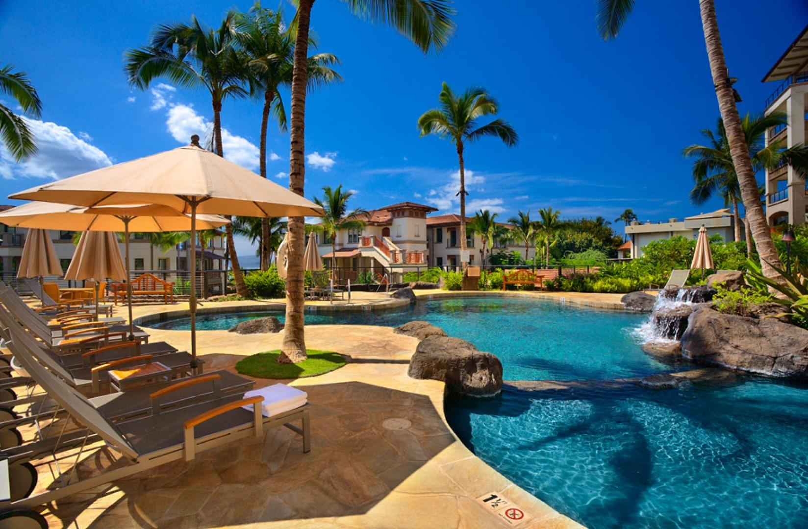 Upper-level family-friendly swimming pool and hot tub, within the center courtyard of the Wailea Beach Villas.