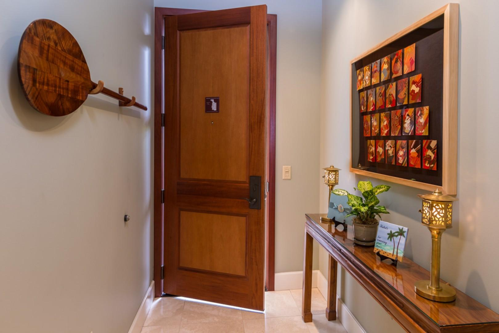 J505 Orient Pacific Suite - Front Door Entry Hallway Decorated with a Koa wood paddle and original art