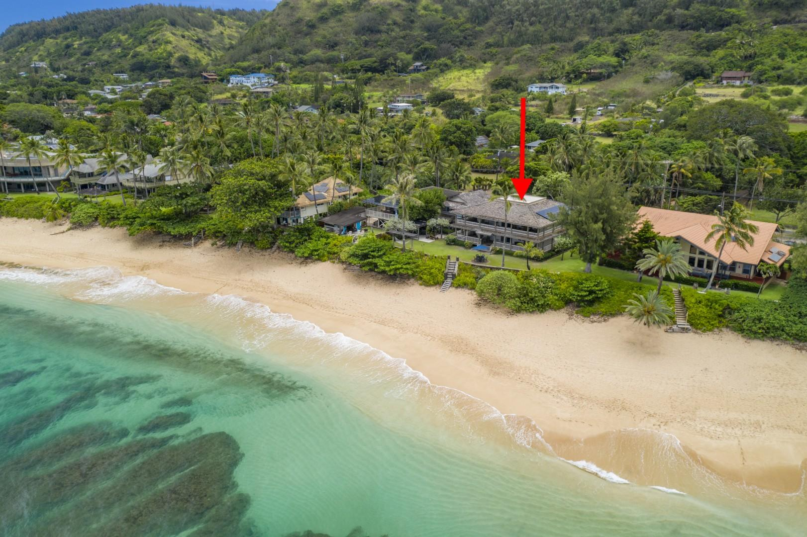 Steps away from the sand, this home sits on a gorgeous coastline perfect for daily beach walks.