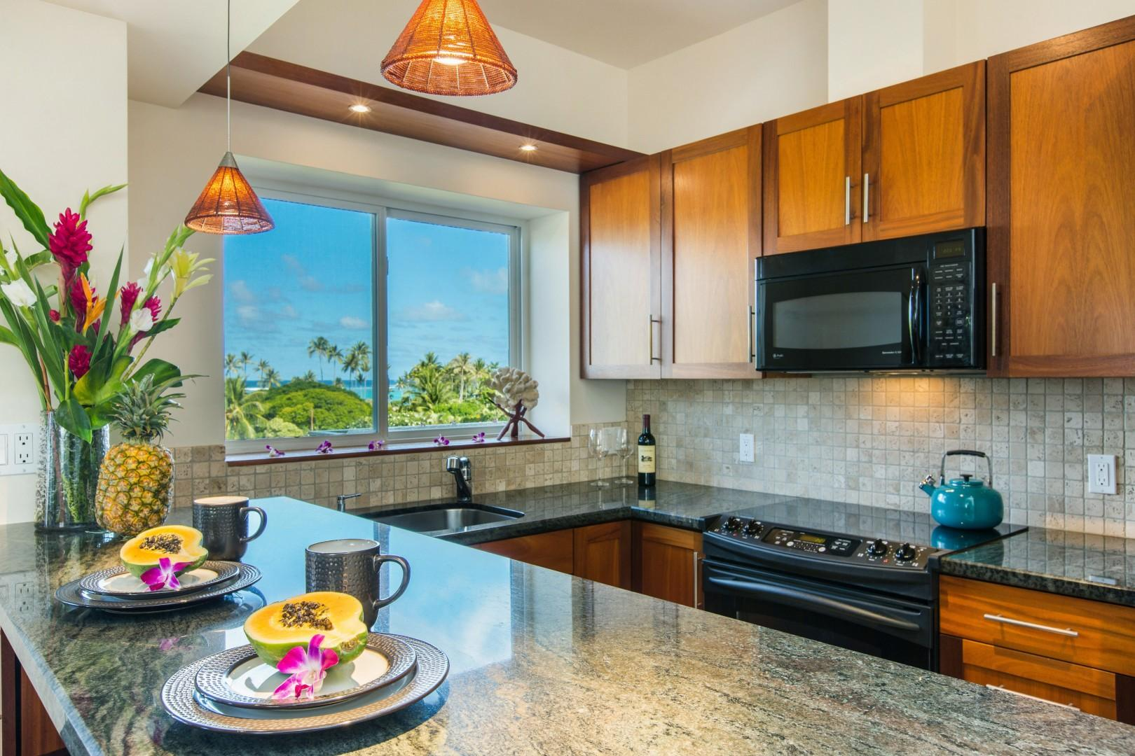 First floor ohana kitchen with an ocean-view lanai outside.