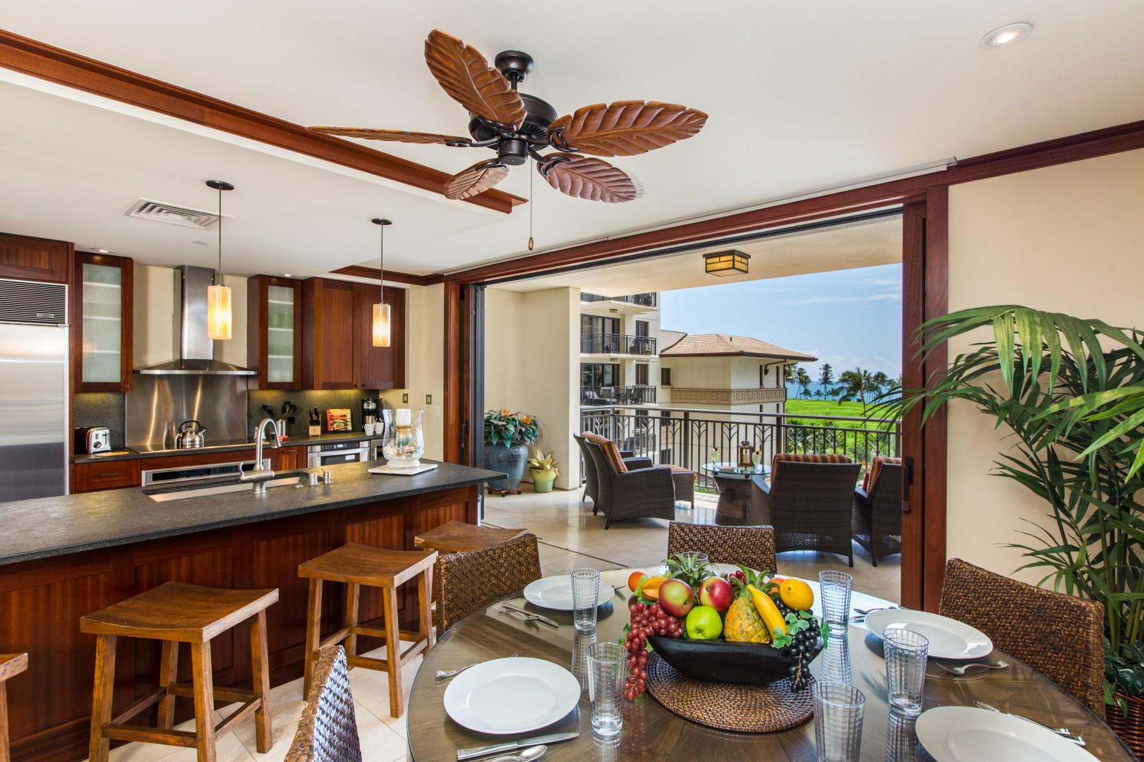 Open concept kitchen, living and dining areas blend indoor and outdoor living when pocket lanai doors are fully opened