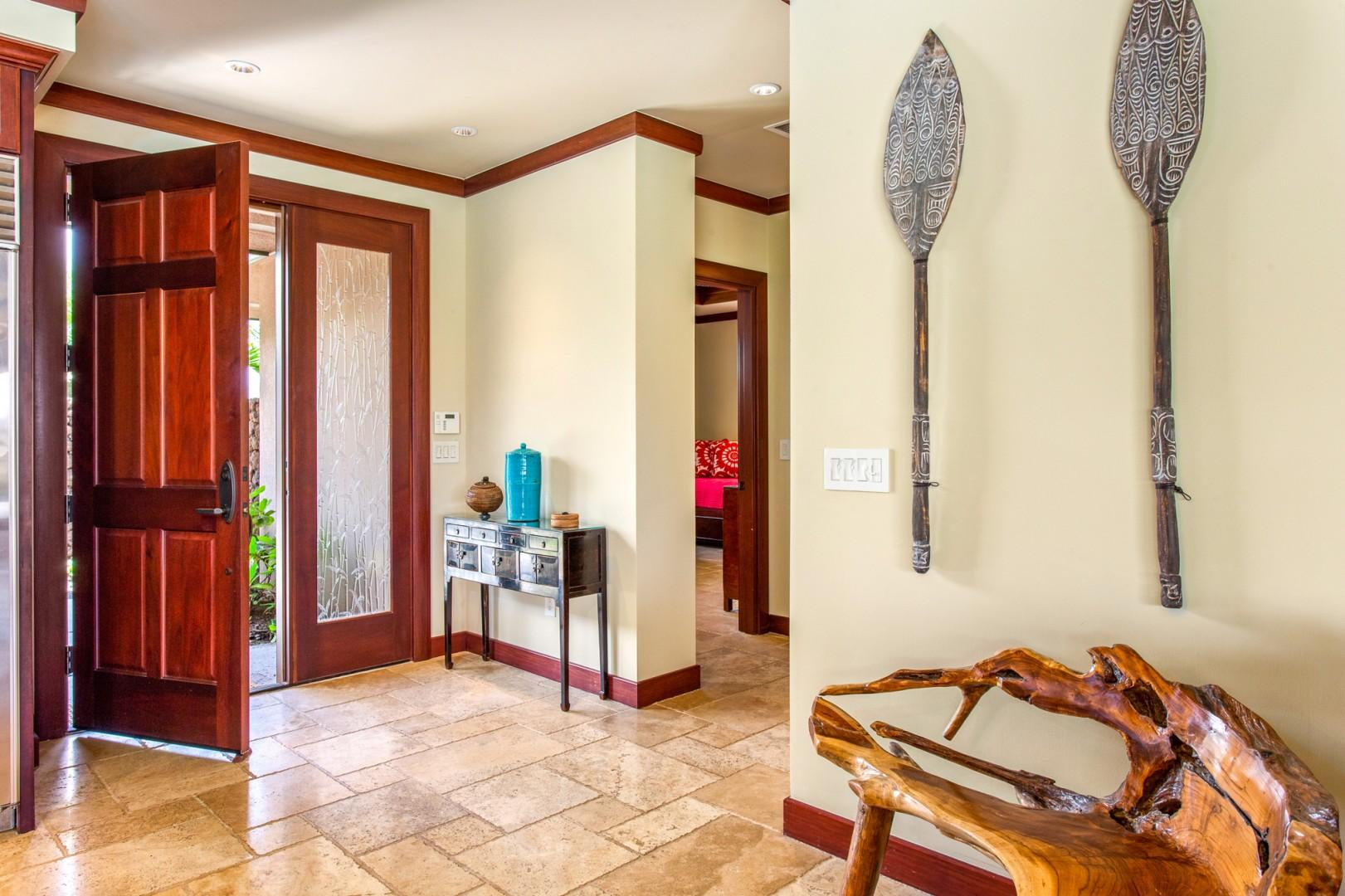 A grand entry door and Hawaiian wall hangings welcome you to your paradise oasis.