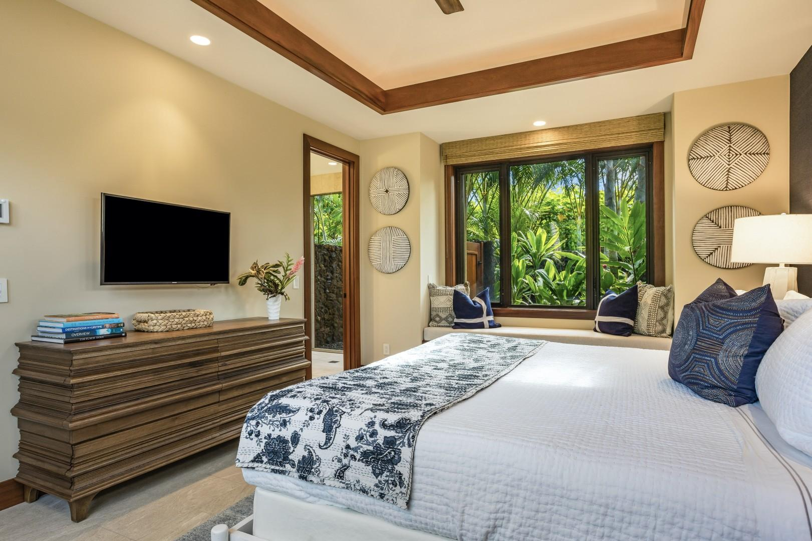 Reverse view of the third guest room showcasing king-sized bed and built in window seating.