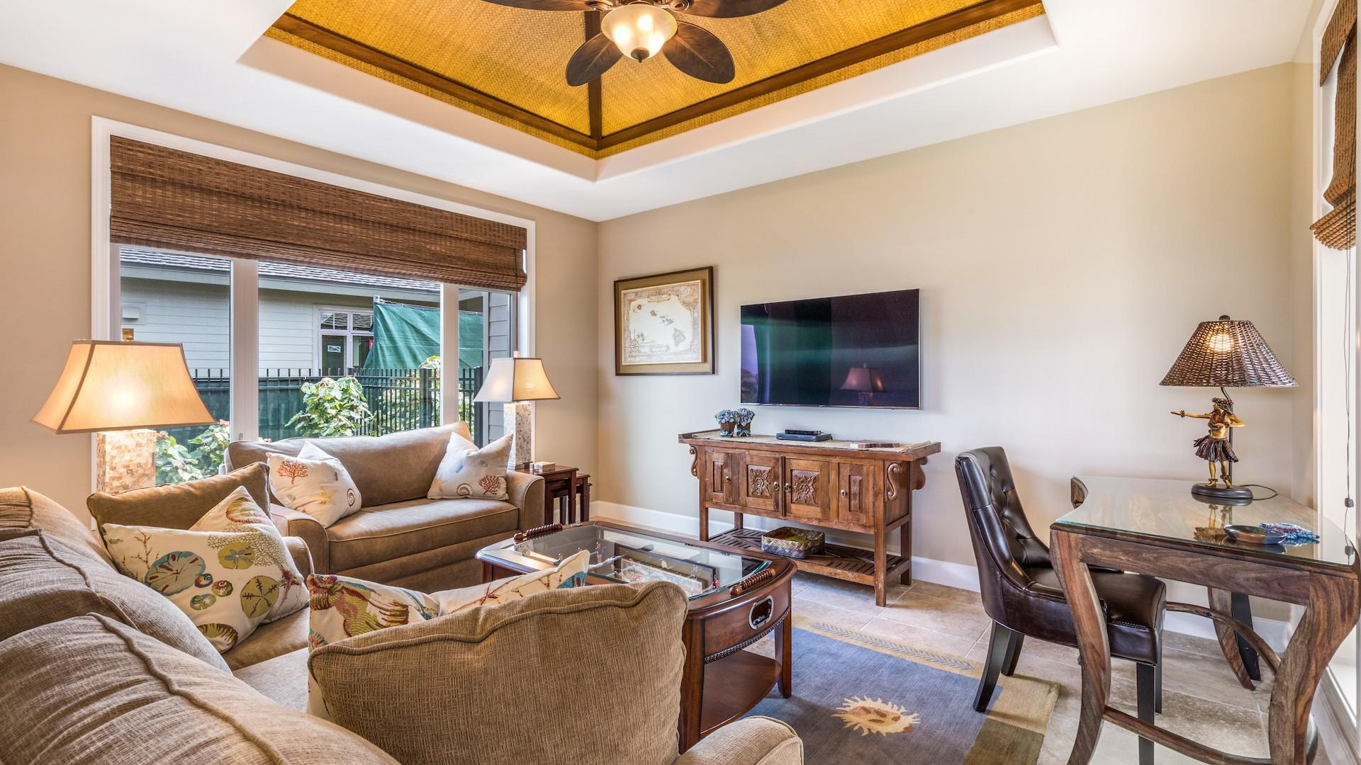 Bonus family room off the kitchen with foosball table, flat-screen TV, and desk area.