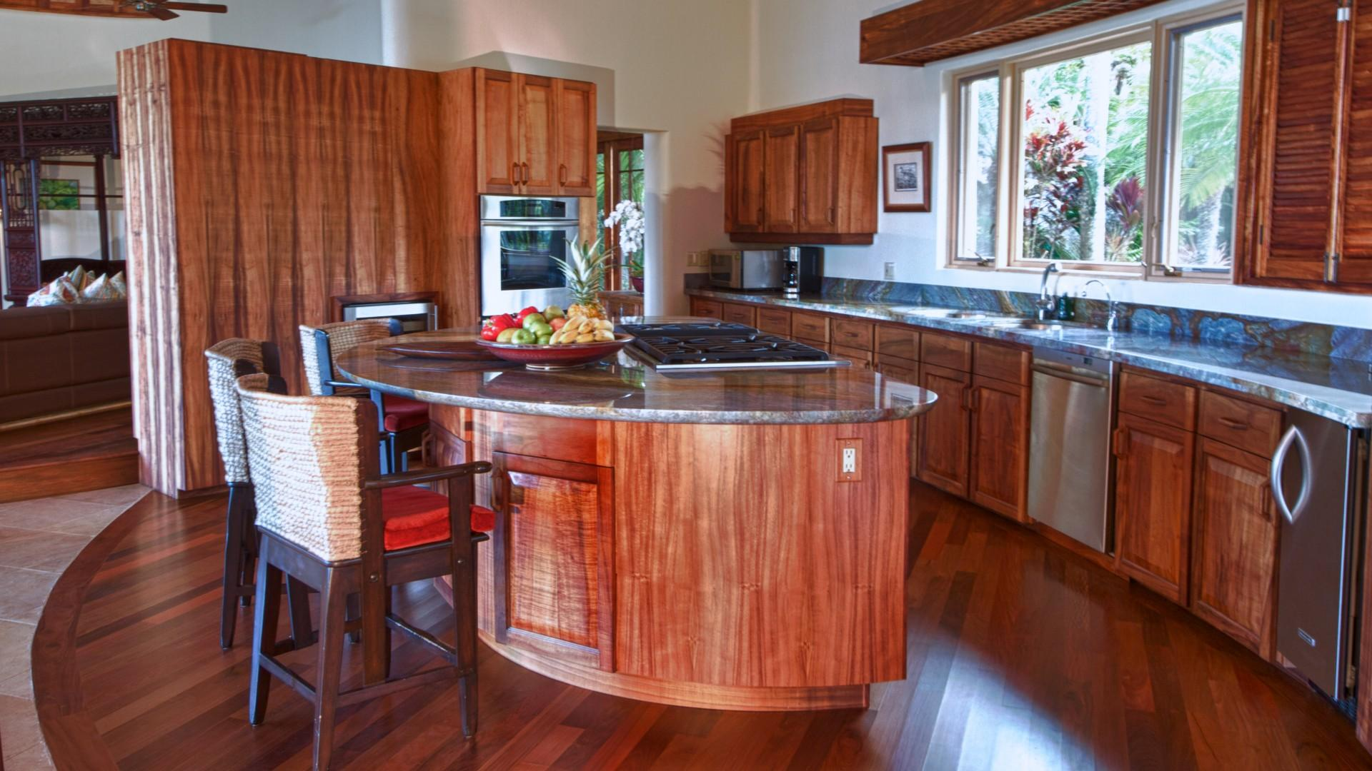 Kitchen in Main House featuring solid Koa wood cabinetry