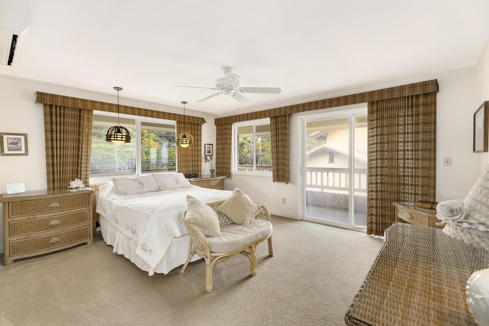 Master bedroom with ensuite bathroom access, split AC, fan, dresser, queen bed, and lanai access.