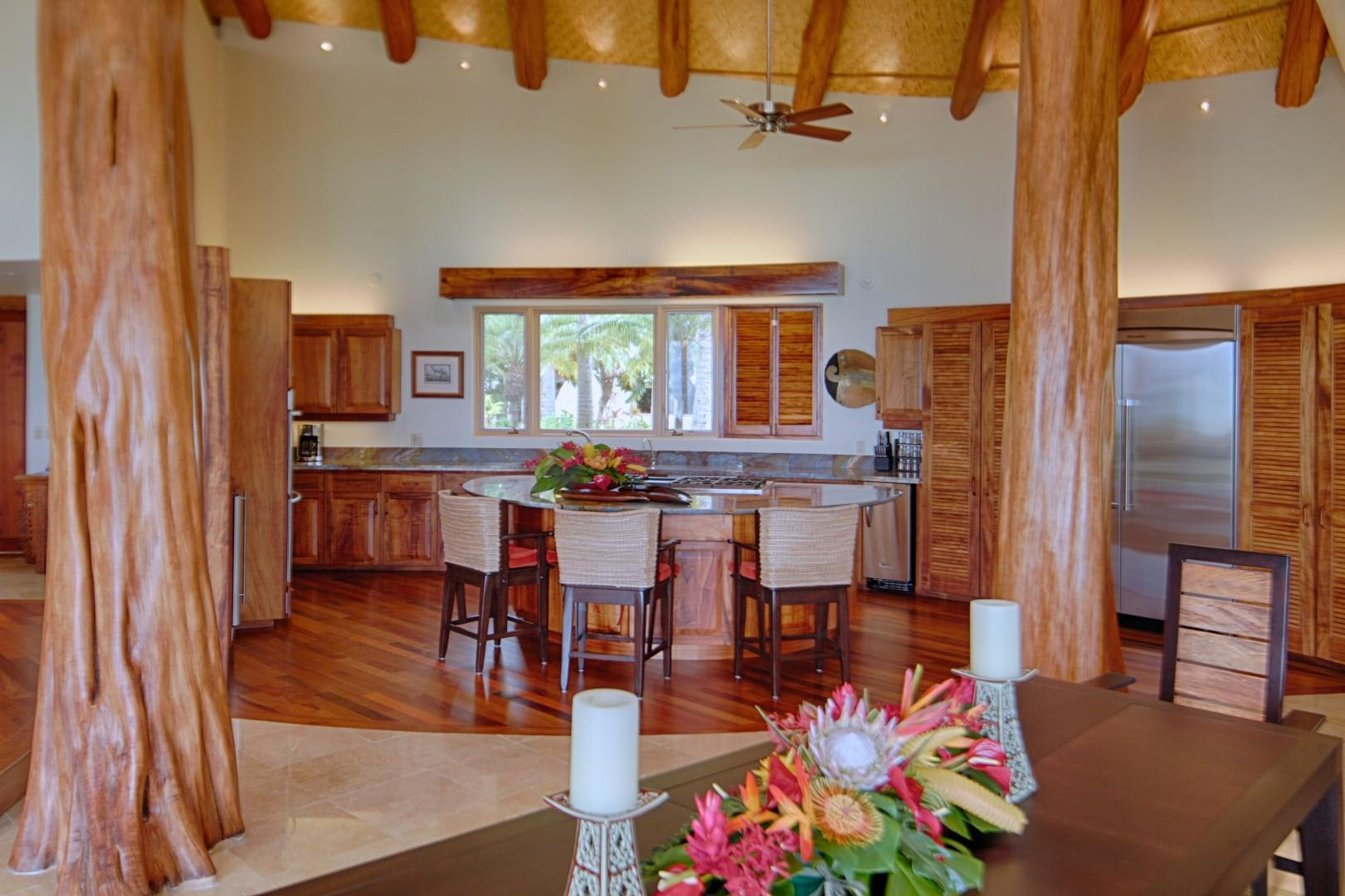 Kitchen framed by Ohia trees in Main House