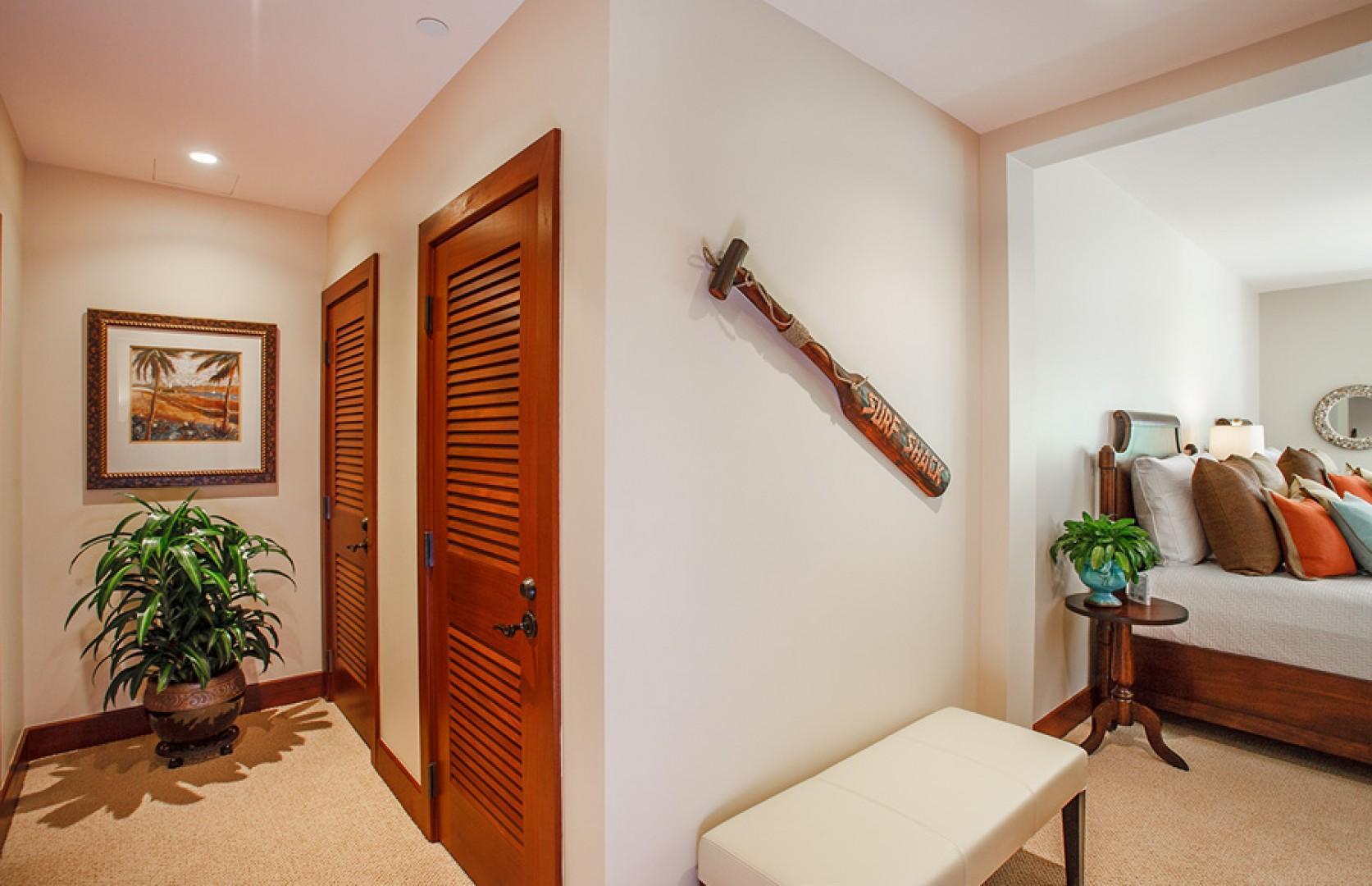 Third bedroom, with two queen-size beds, en suite bath, desk, and garden/patio access.