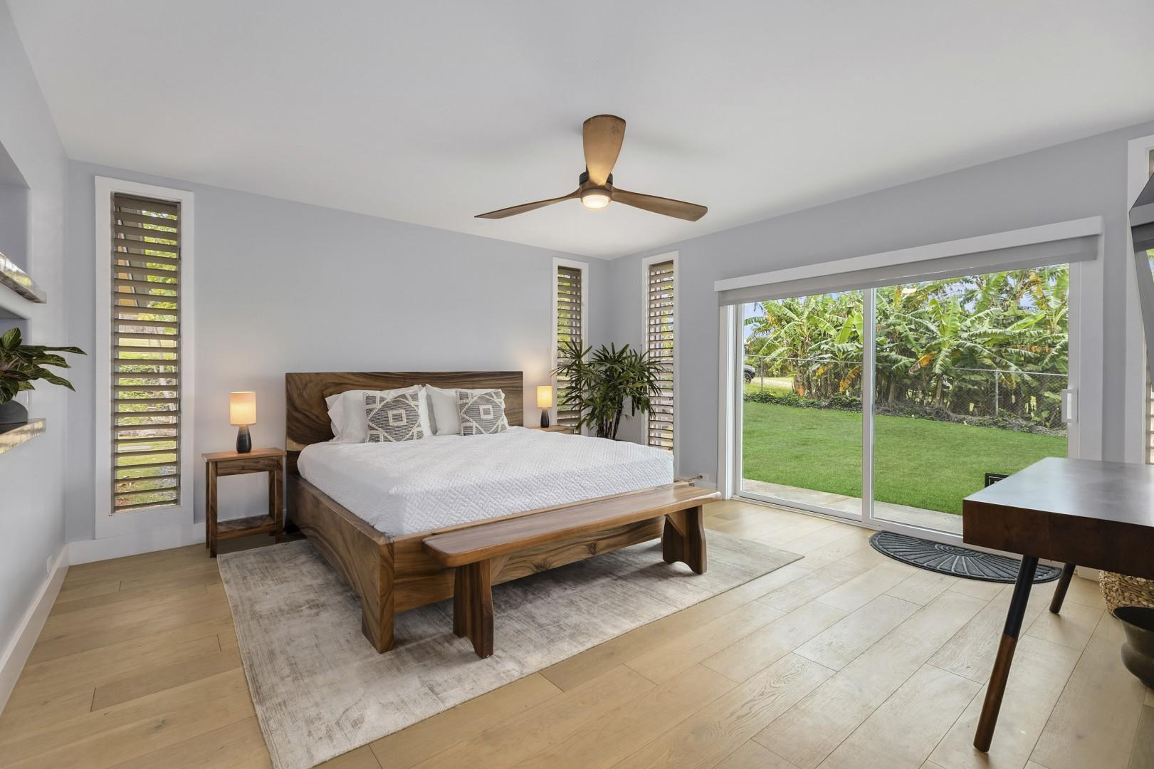 Master bedroom with king sized bed, study desk, and smart TV