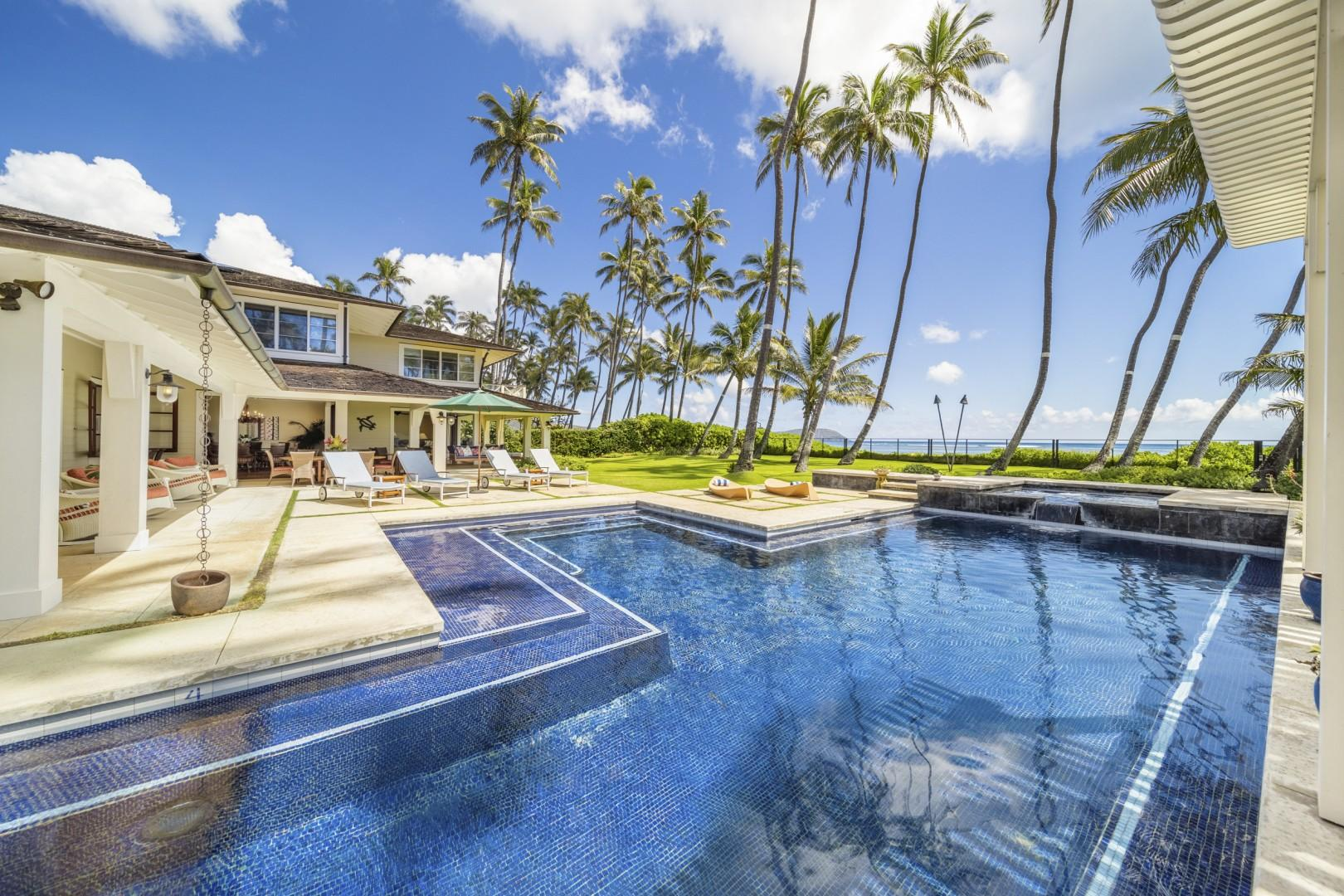 Luxurious pool area with views of the beach