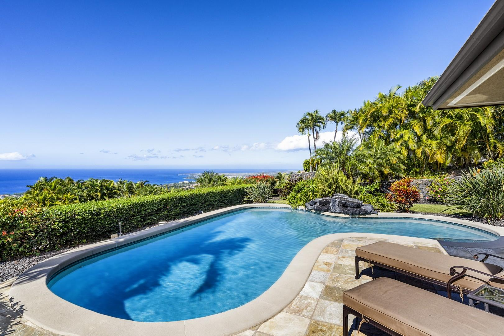 Relax in the pool while taking in the Kona Coast!