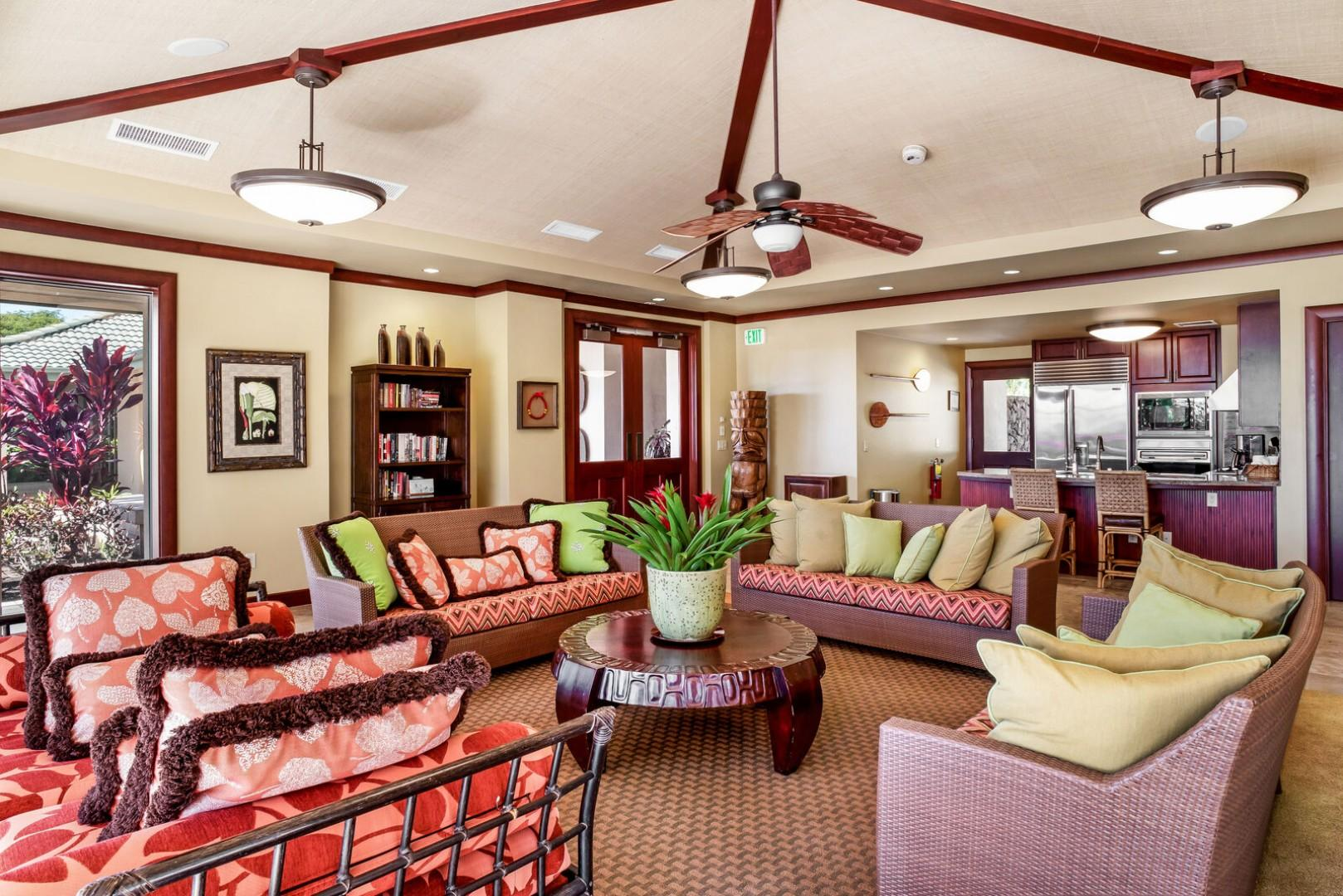 Wai'ula'ua Amenities Center: shared lounge area with kitchen in background.