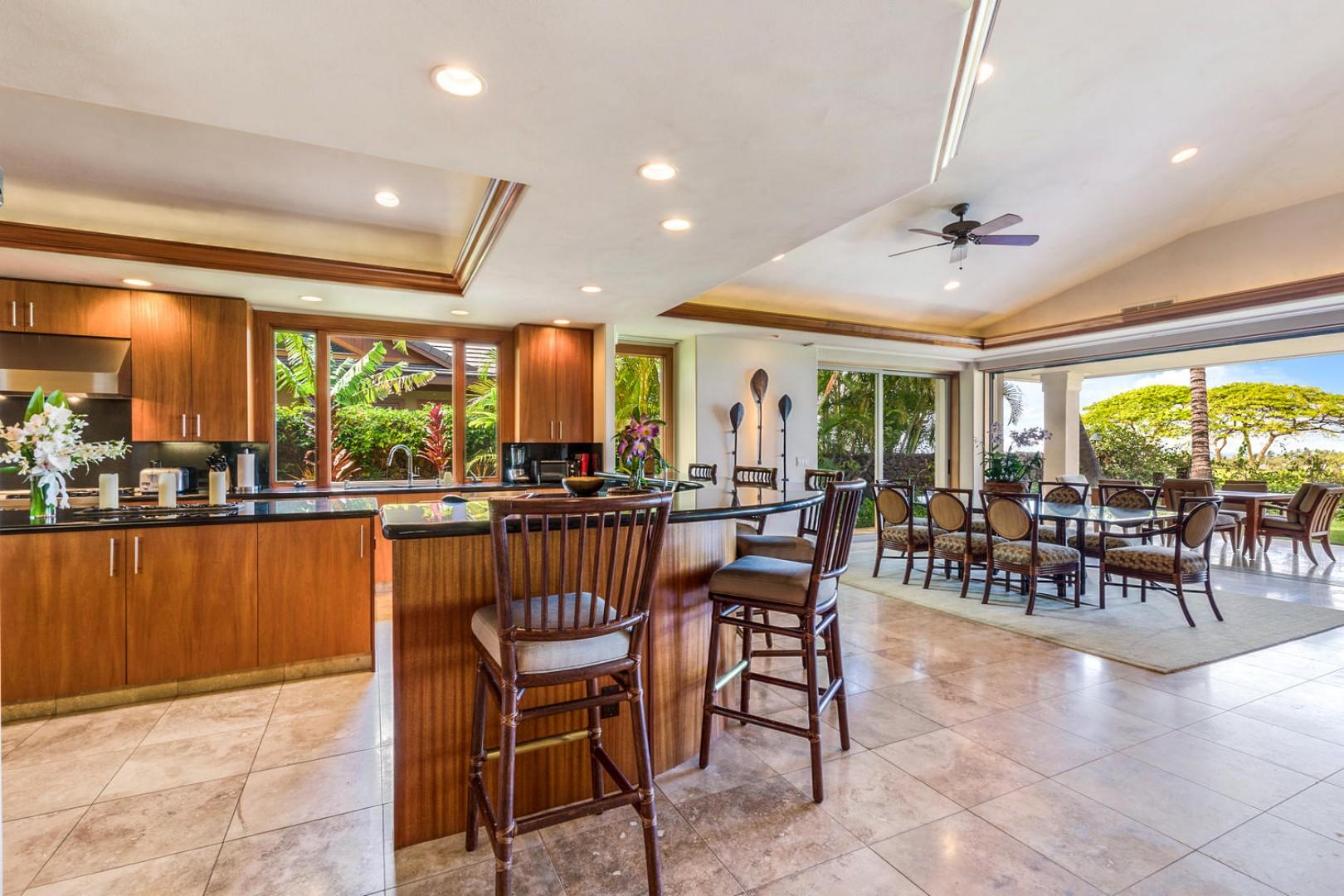 Wide view of kitchen bar seating and formal dining area for eight, with lanai seating beyond.