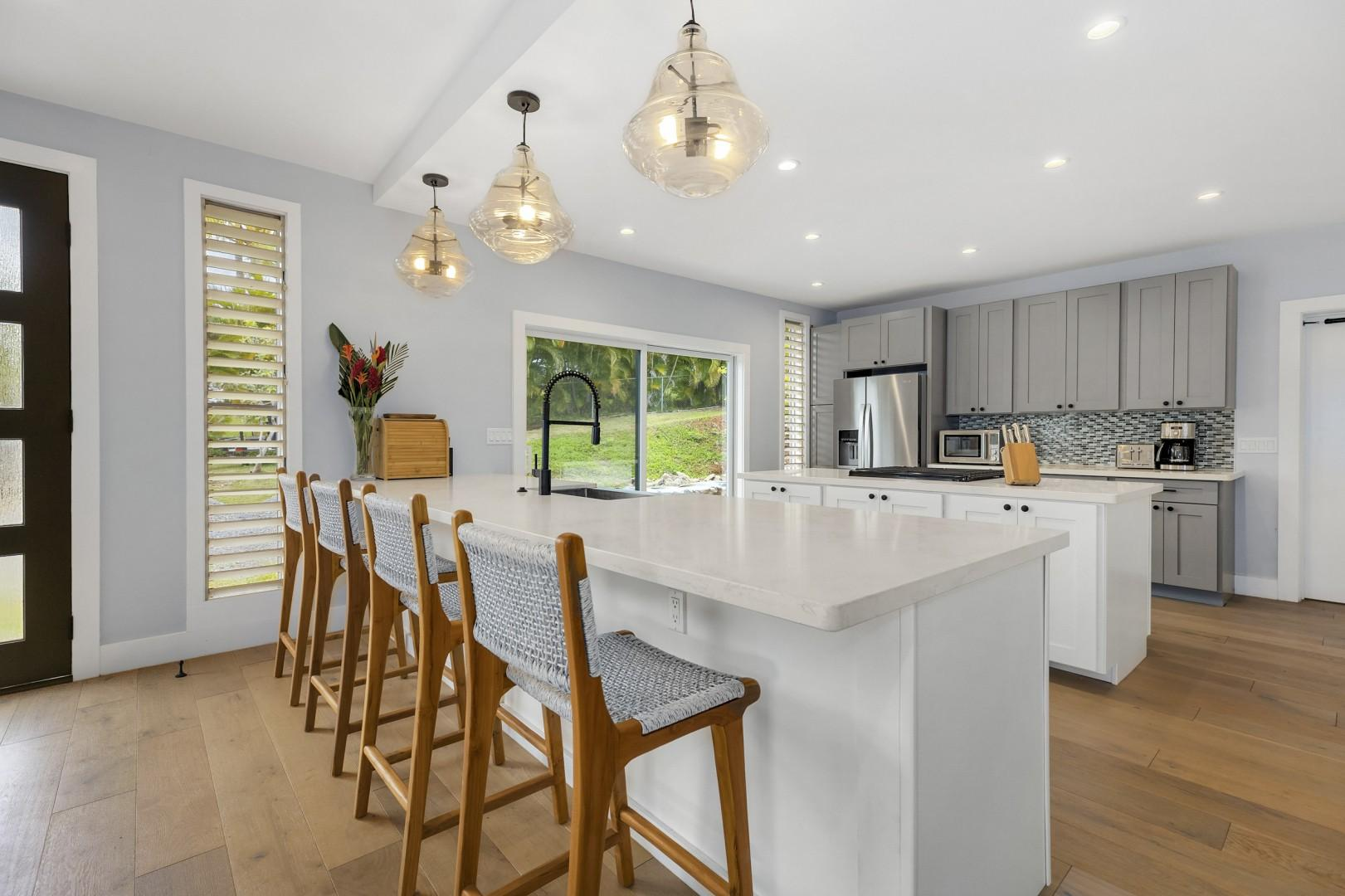 Spacious kitchen with custom cabinetry, gas stovetop, and stainless appliances. Half bath located in the kitchen.