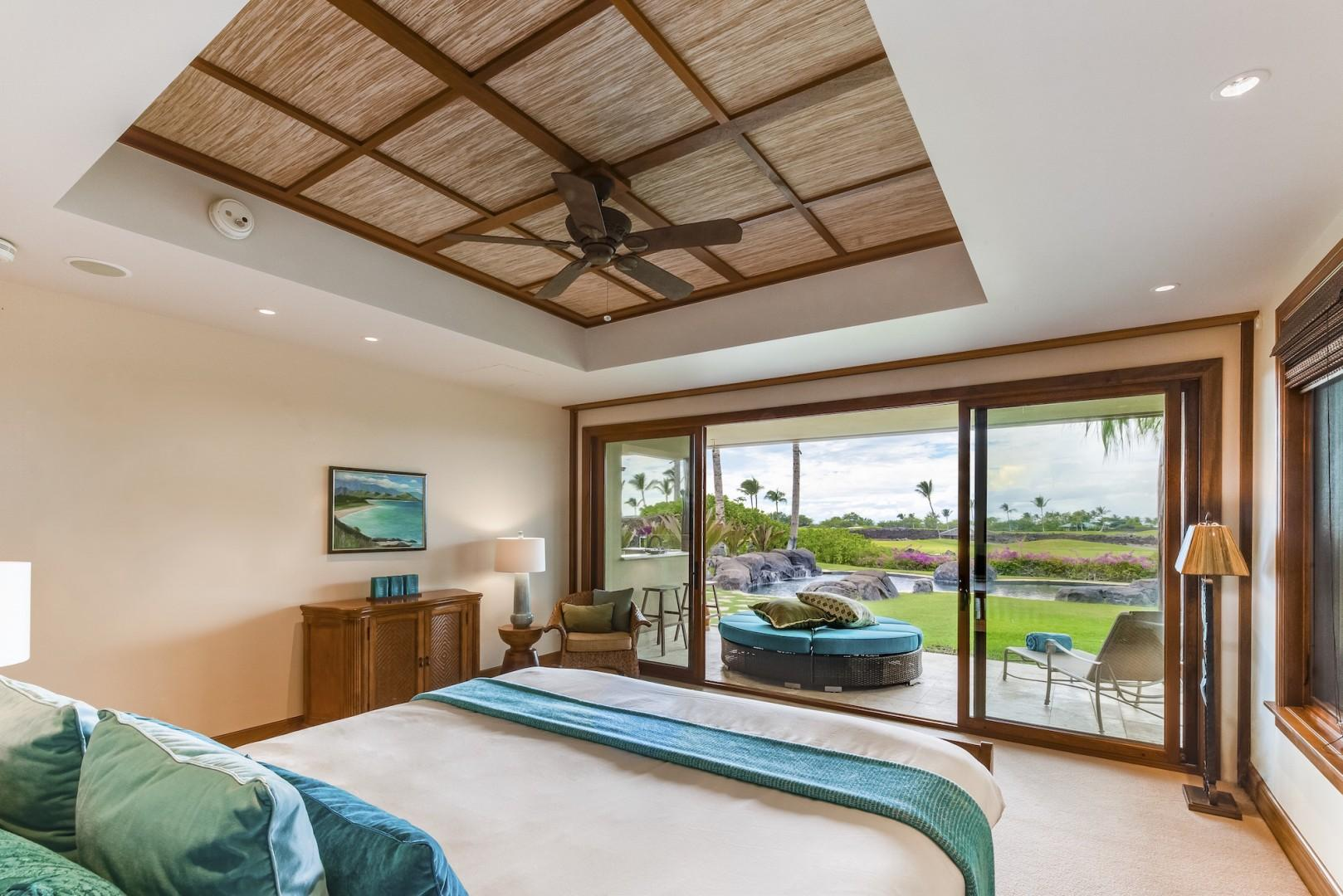 Downstairs Master Bedroom w/ Electronic Pocket Doors Open to Separate Lanai and Pool Area.