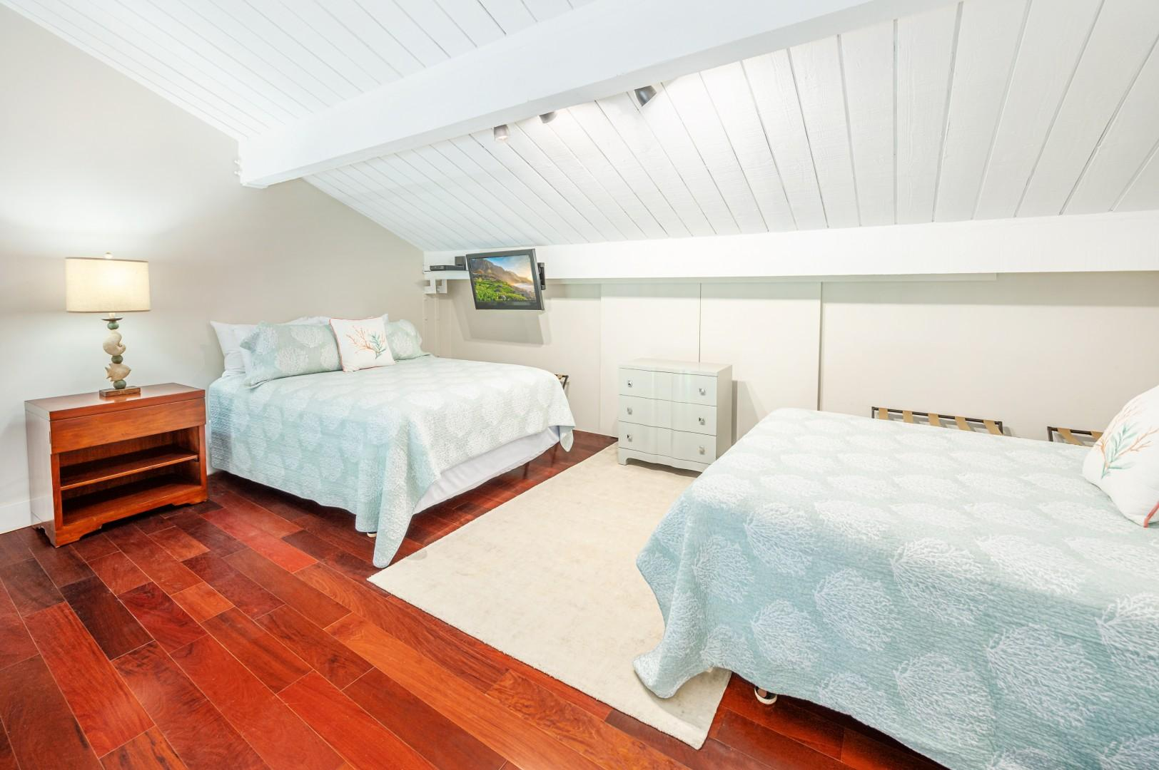 Two queen beds in the loft area