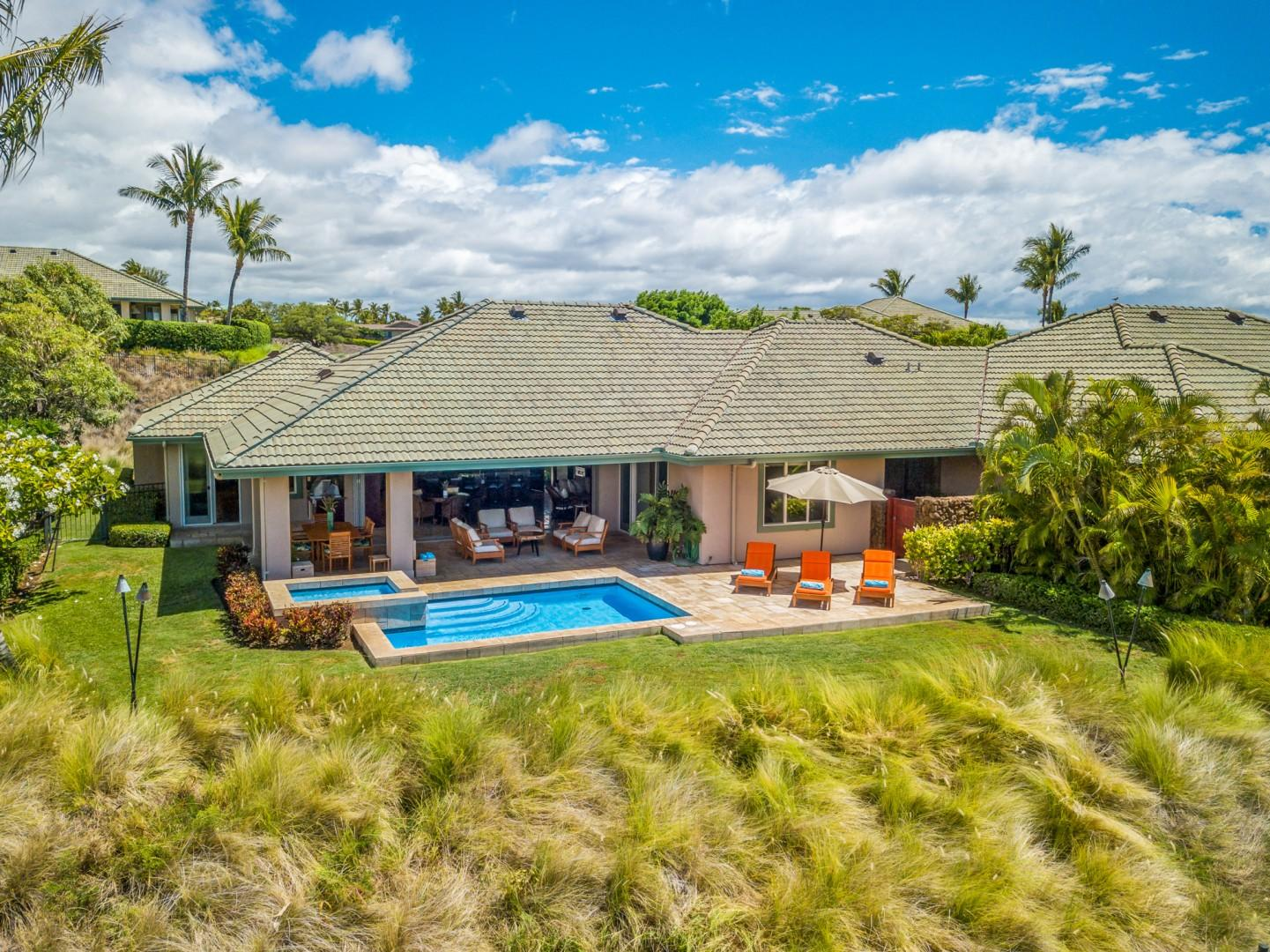 Aerial view of home showcasing privacy, spacious covered lanai and open air pool deck.