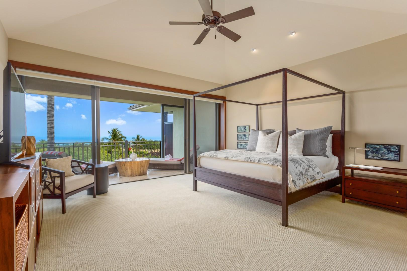 Master suite with private ocean-view deck, king-size bed, large flat-screen TV, and electric drop-down blinds.