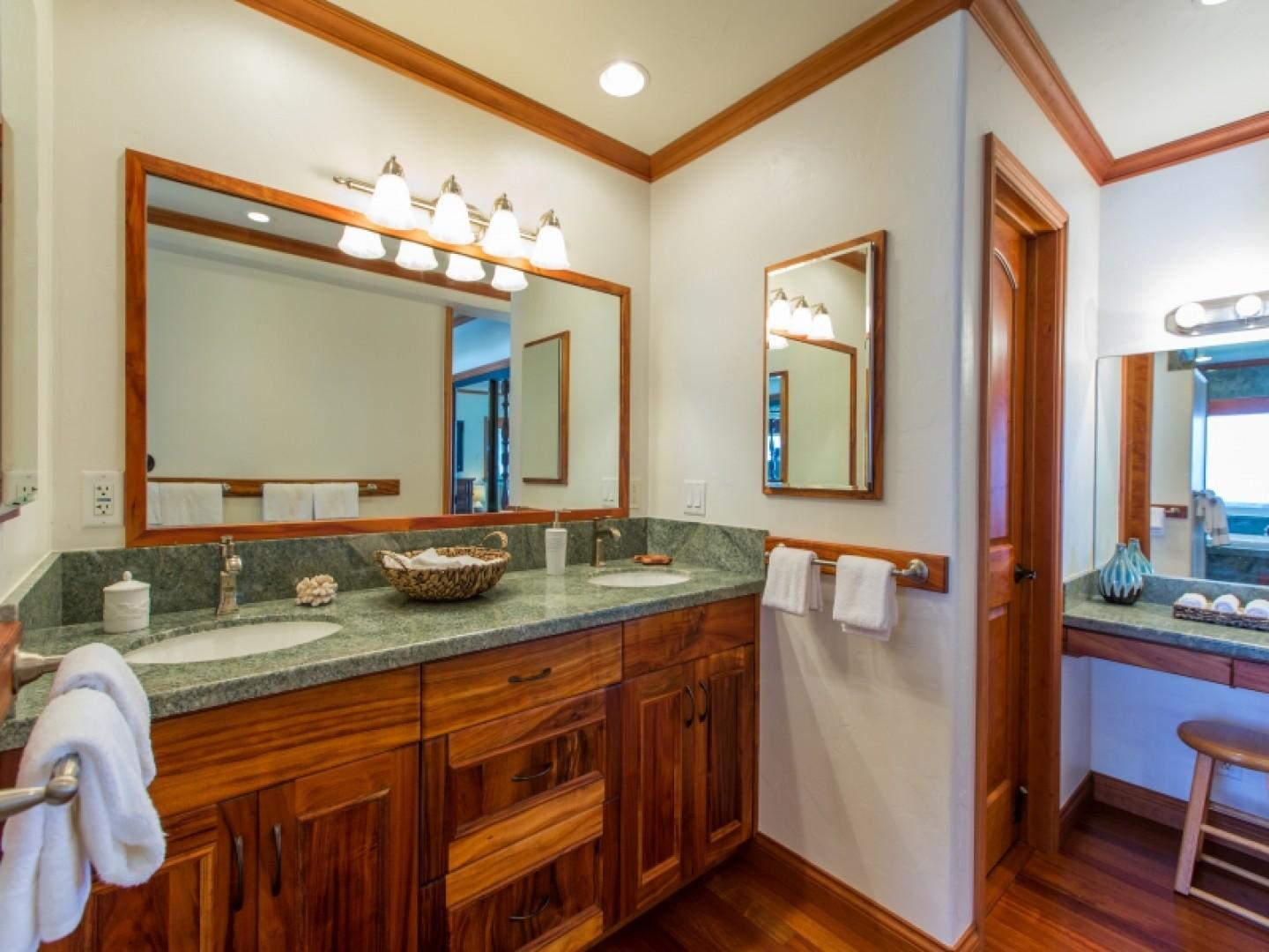 Master suite bathroom with private vanity area.