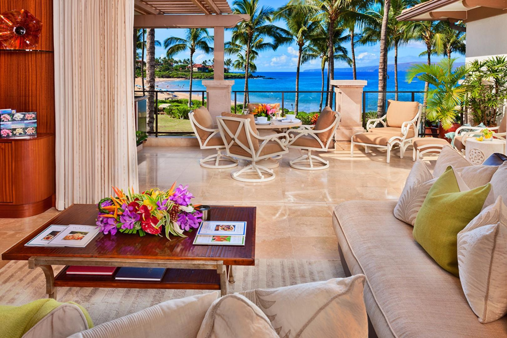 The Beautiful Great Room of A201 Royal Ilima - Looking Towards Wailea Beach. Live Plants, Custom Cabinetry, Down-Filled Furniture, Original Art, Pacific Artifacts and Gallery-Quality Decor
