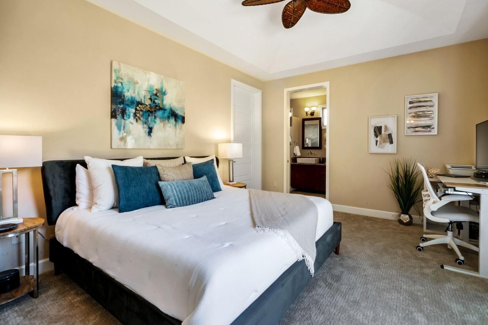Guest bedroom equipped with King bed, A/C, TV, Lanai access, and work space