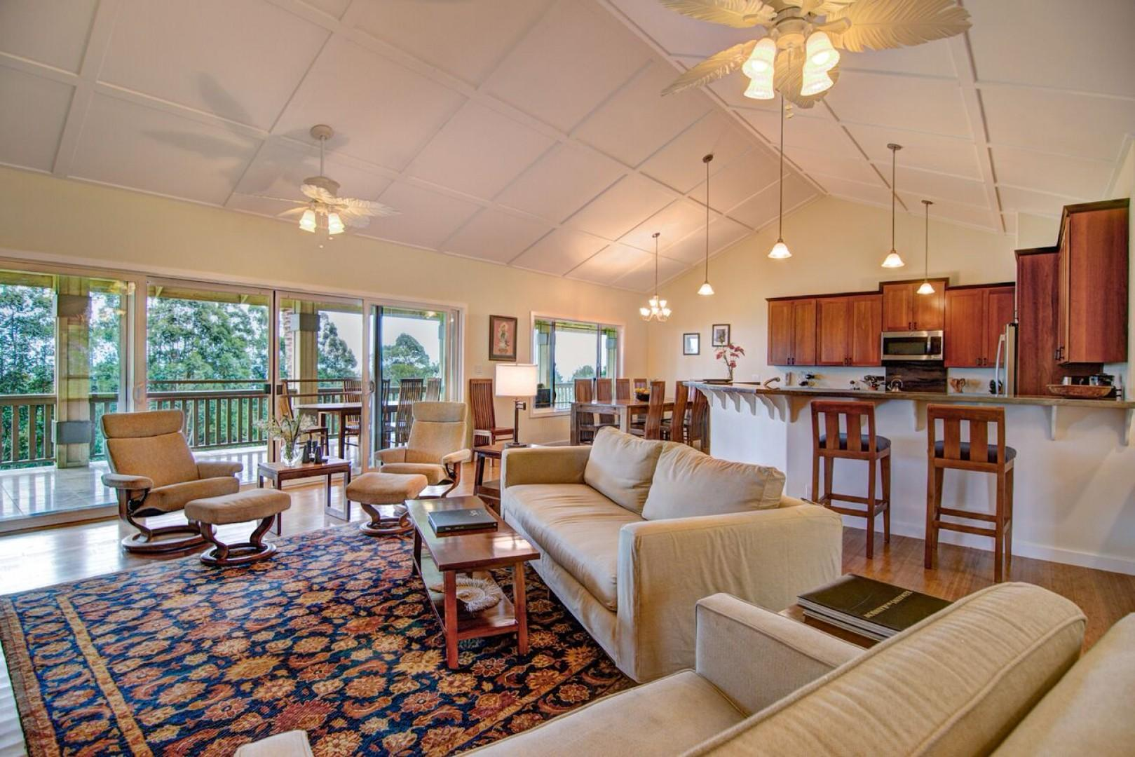 The entire living area opens to the 60 foot long back lanai with ocean and garden views
