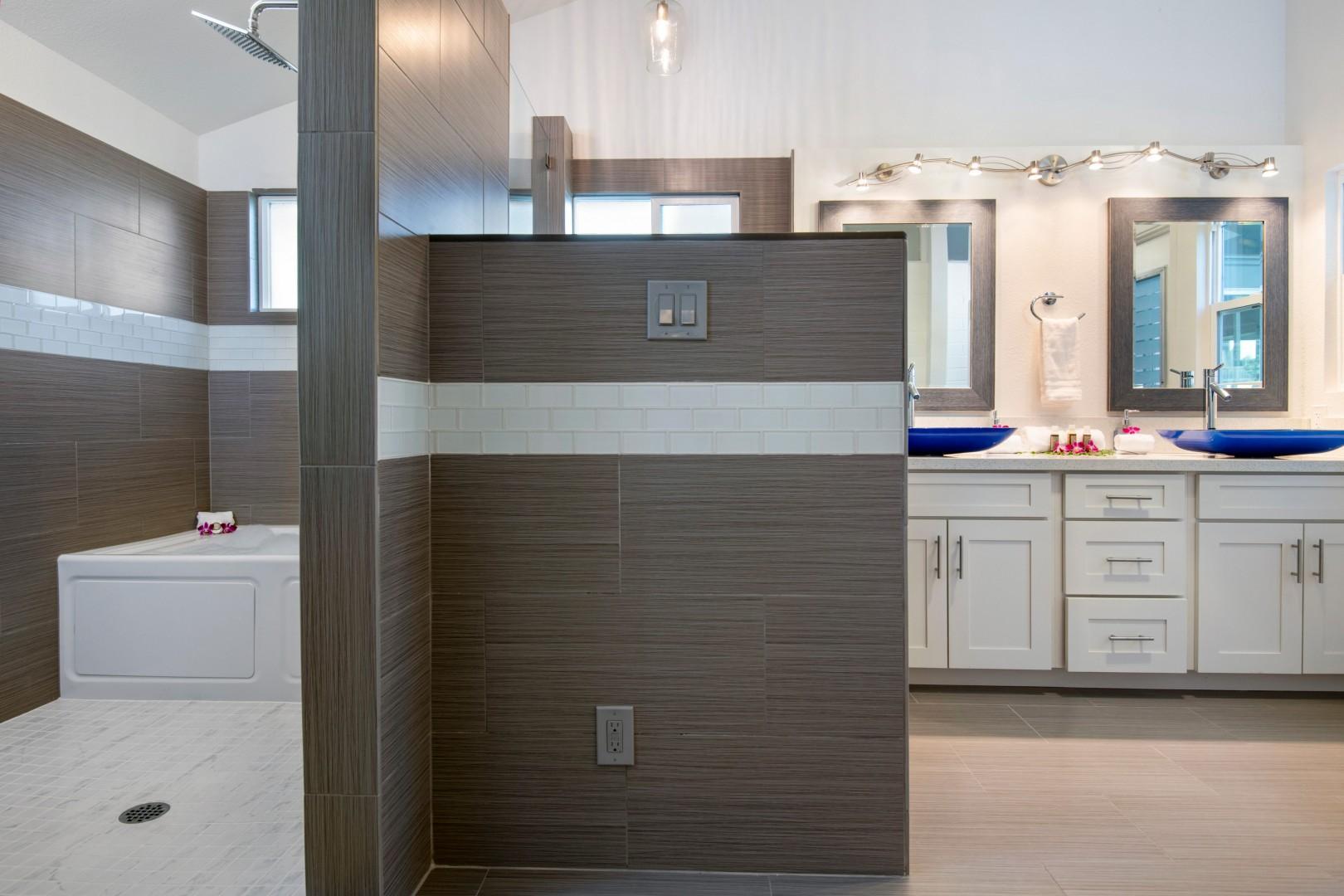 Master en-suite bathroom view. Walk in shower and bath, private toilet nook.