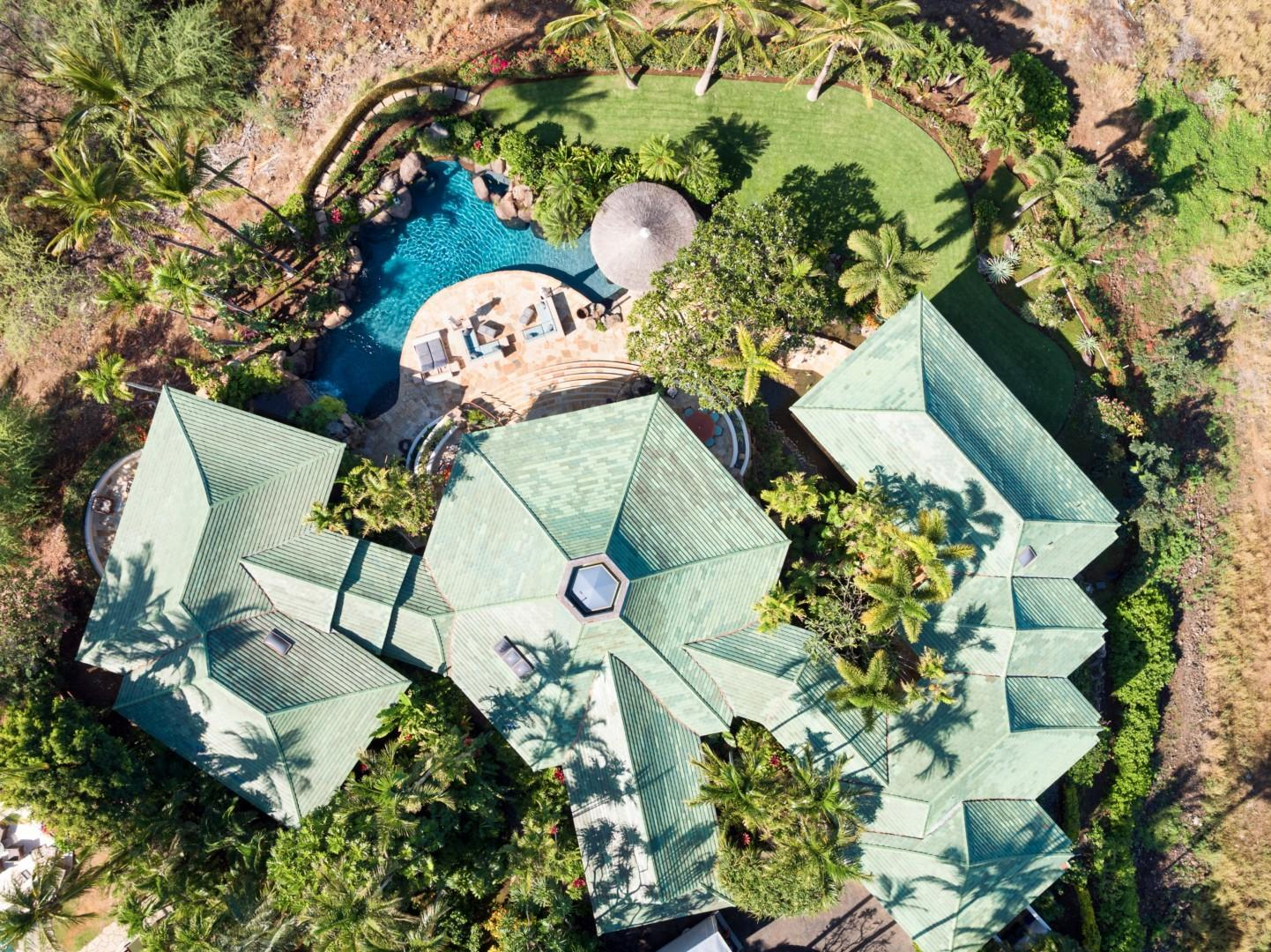 Aerial view of pod-style home offering scope and layout of this incredible architectural gem. Master suite on left, great room in center, four bedroom suites on right.