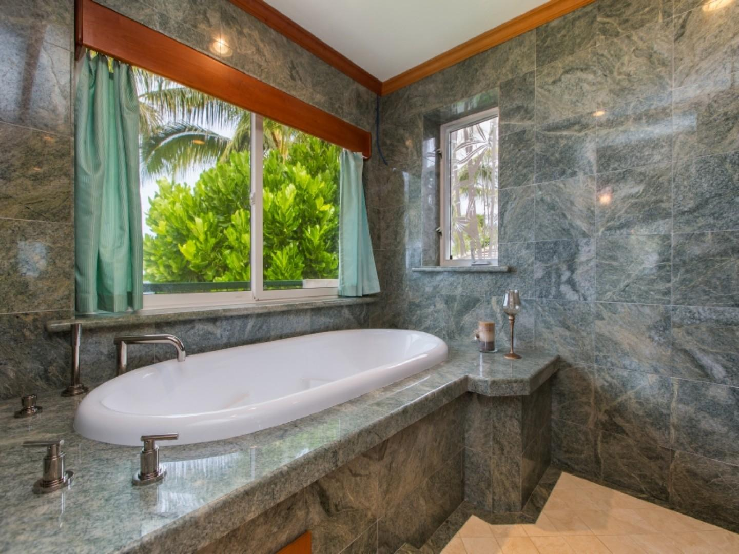 Master suite jacuzzi tub with ocean view.