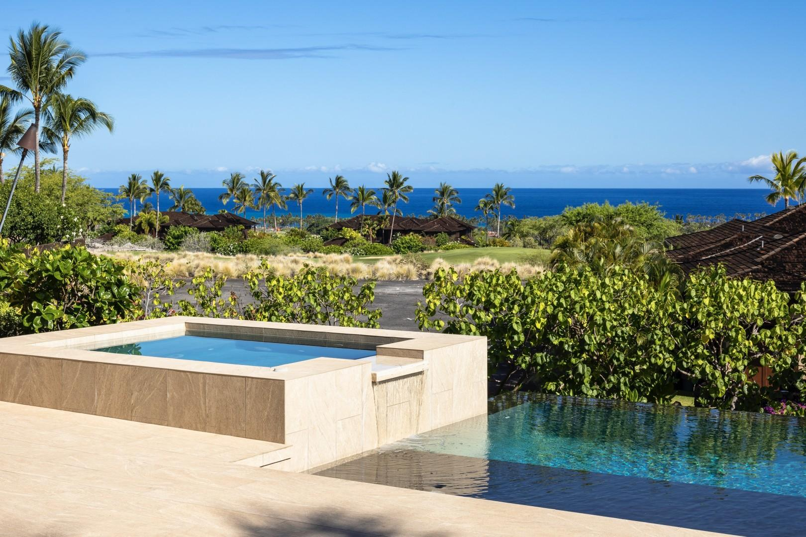 Contemporary design elements delight the senses, like this overflow waterfall from private spa to infinity pool.