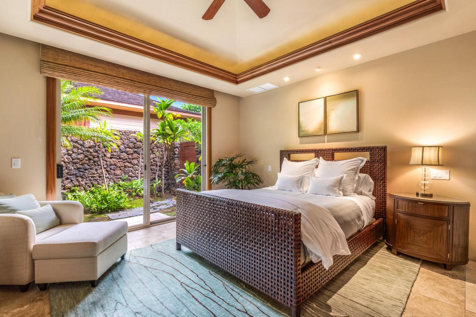 Second guest suite w/private entrance, queen bed, wall mounted flat screen television, sliding doors to outdoor living and en-suite bath.