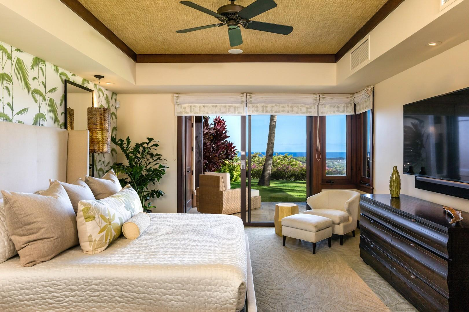 Master suite with private ocean-view deck, king-size bed, and large flat-screen TV with Sonos Sound Bar.