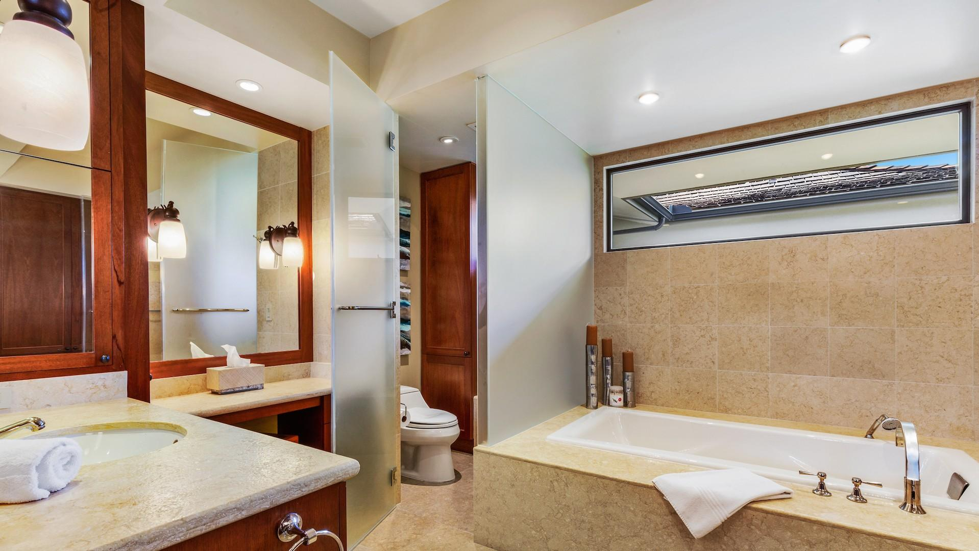 Master bath with jetted tub and dual sinks.