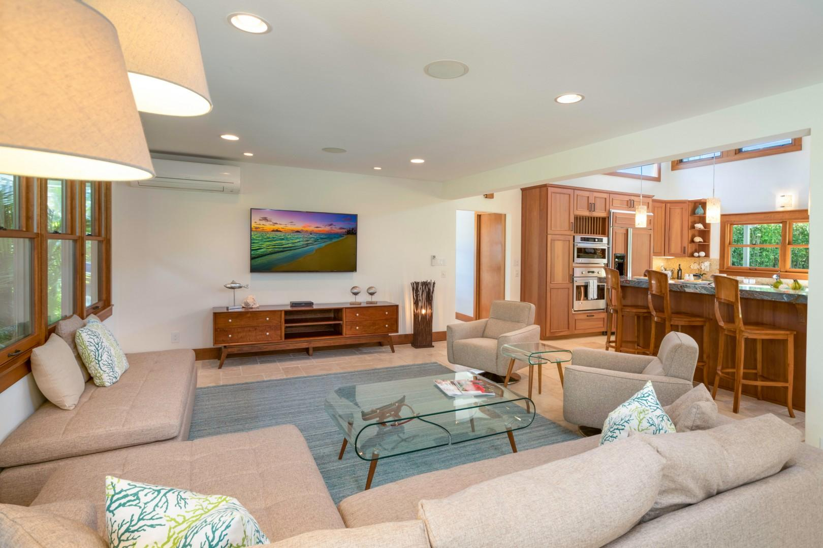 The living room is attached to the kitchen and dining room. With an L-shape couch, there is enough space for everyone to watch a movie or TV.