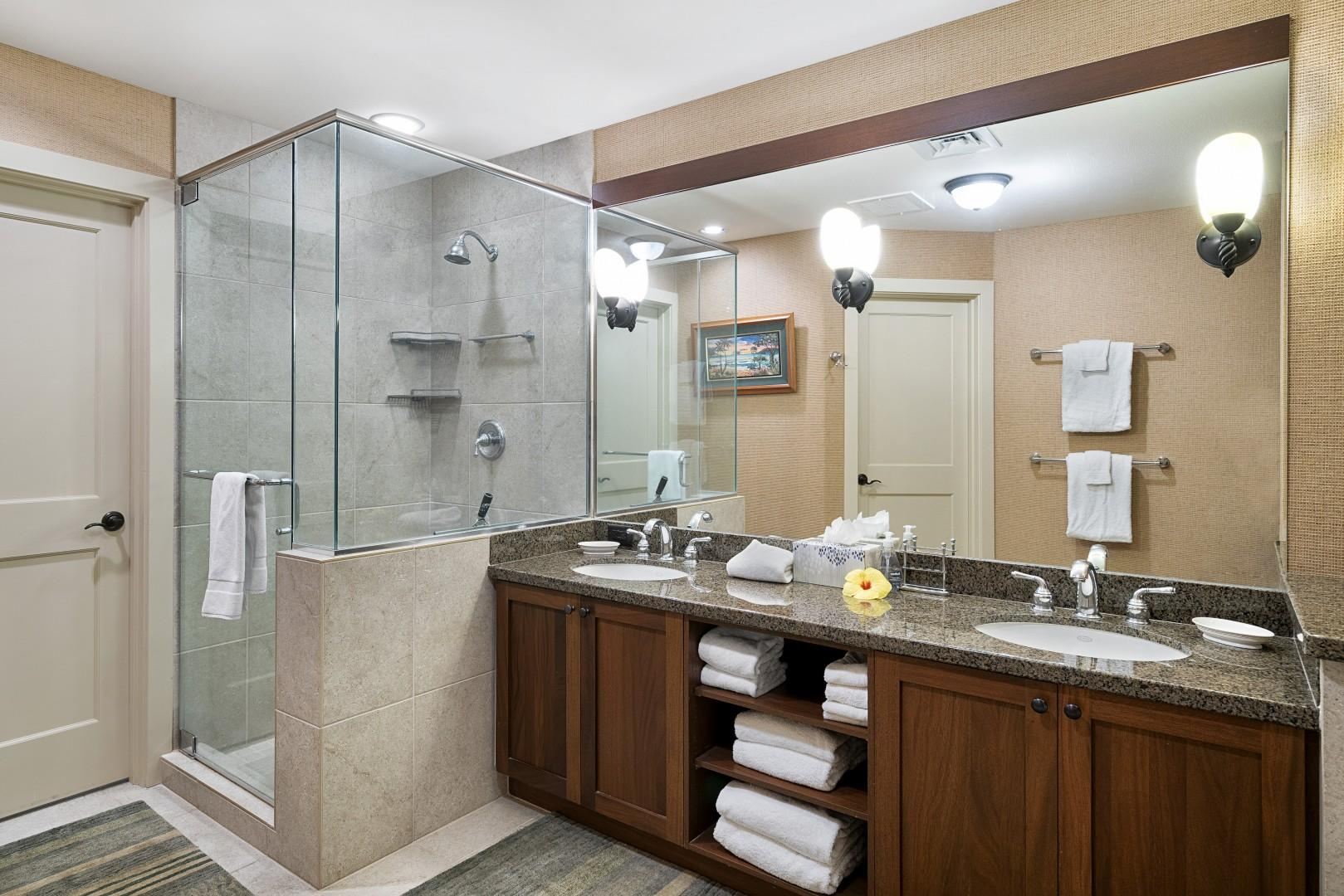 Dual vanities and walk-in shower featured in the Master Bath!
