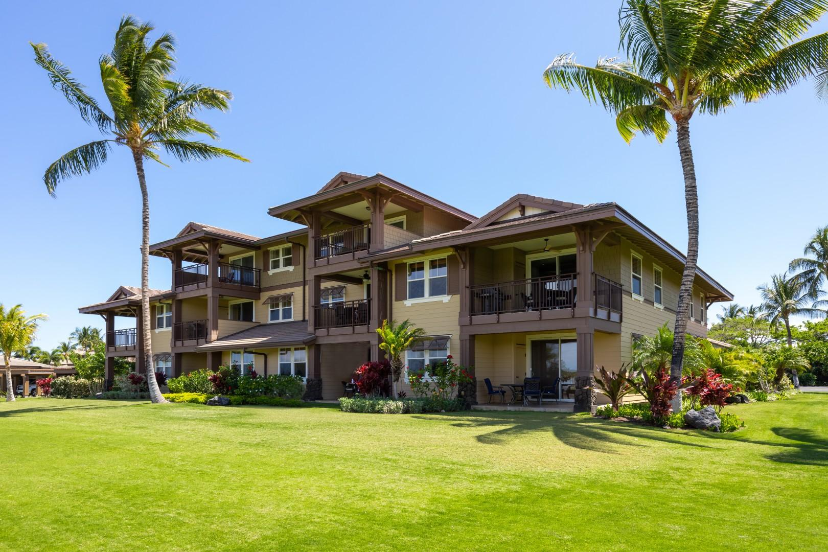 The golf front side of the building has beautiful tropical landscaping.