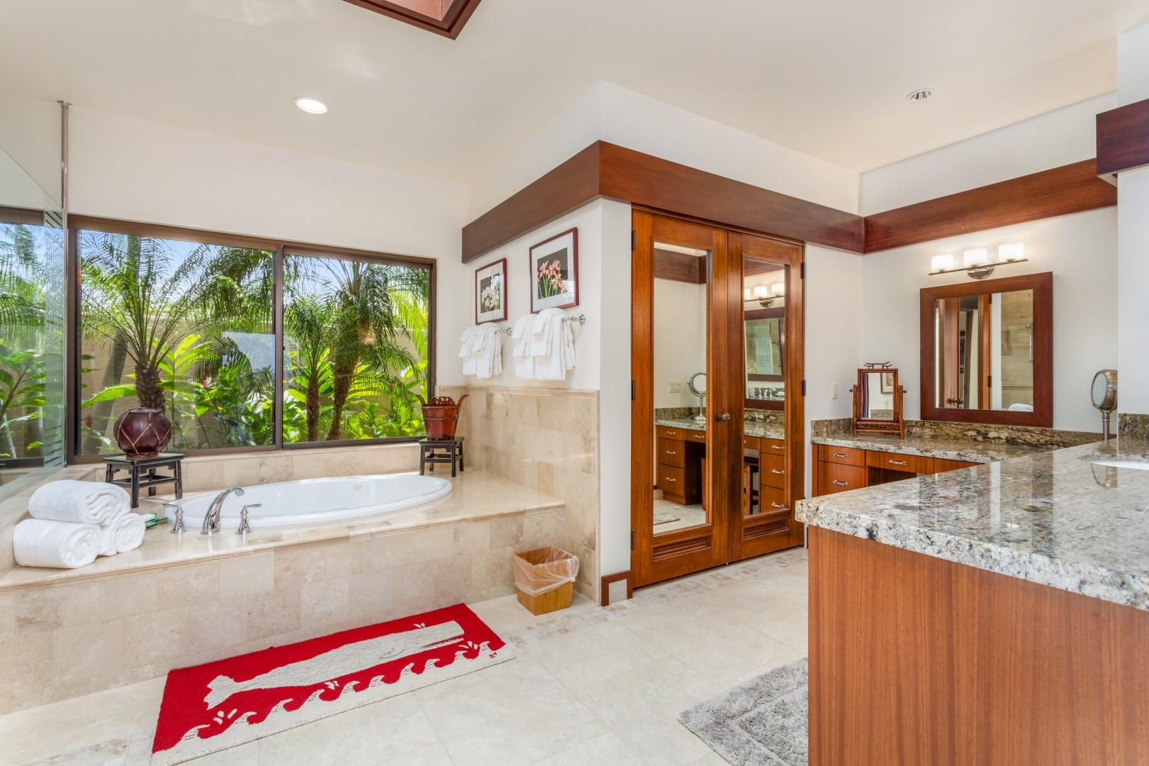 Master bathroom with soaking tub, dual vanity, walk-in shower, and separate commode for privacy.